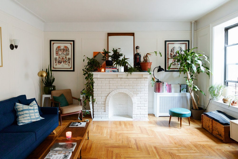 big living room with white painted fireplace