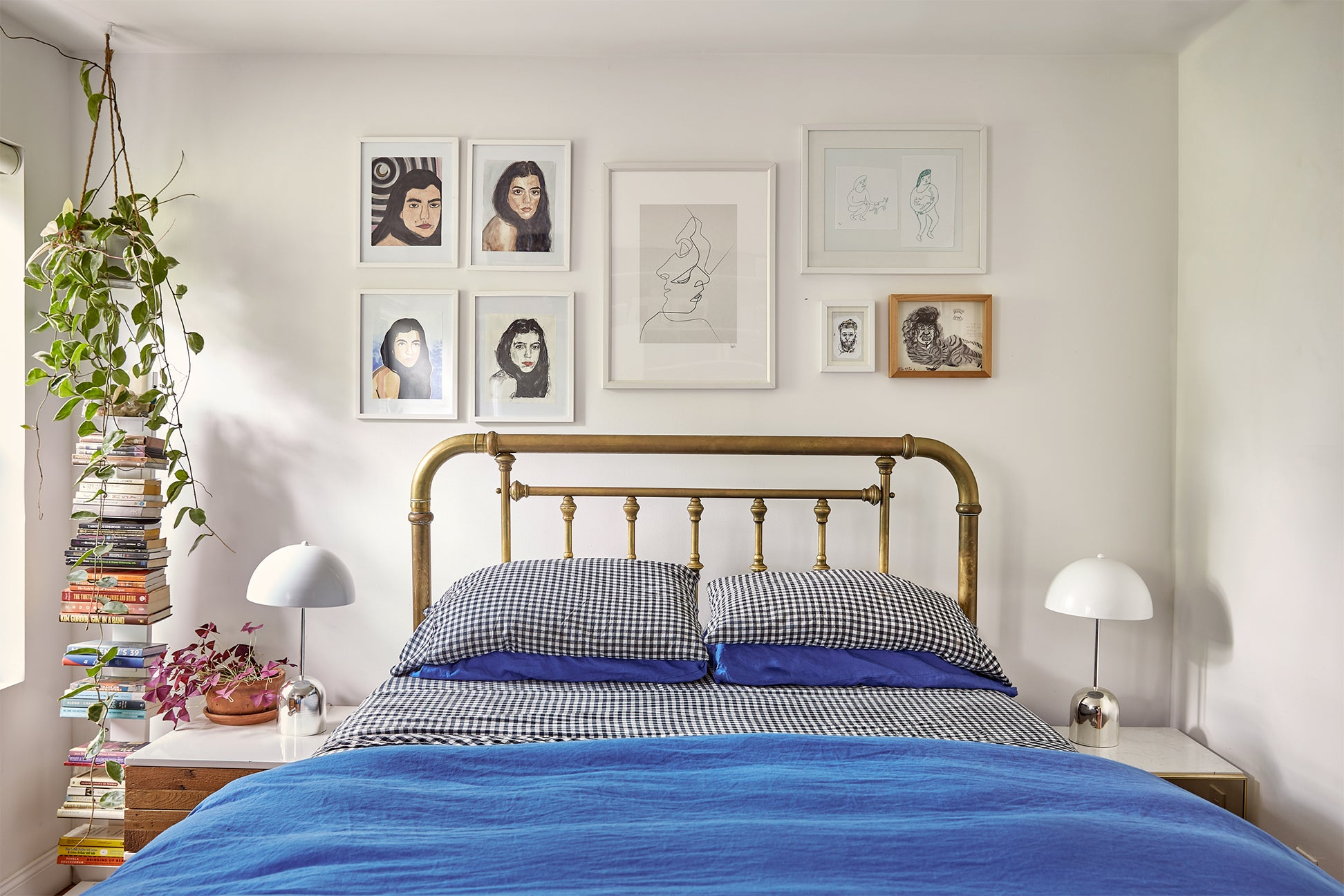Bedroom with brass bed and blue quilt