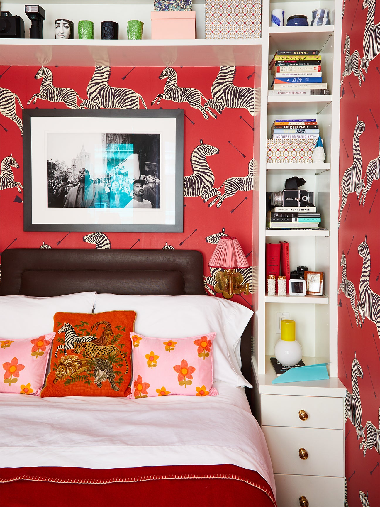 Small bedroom with red zebra wallpaper
