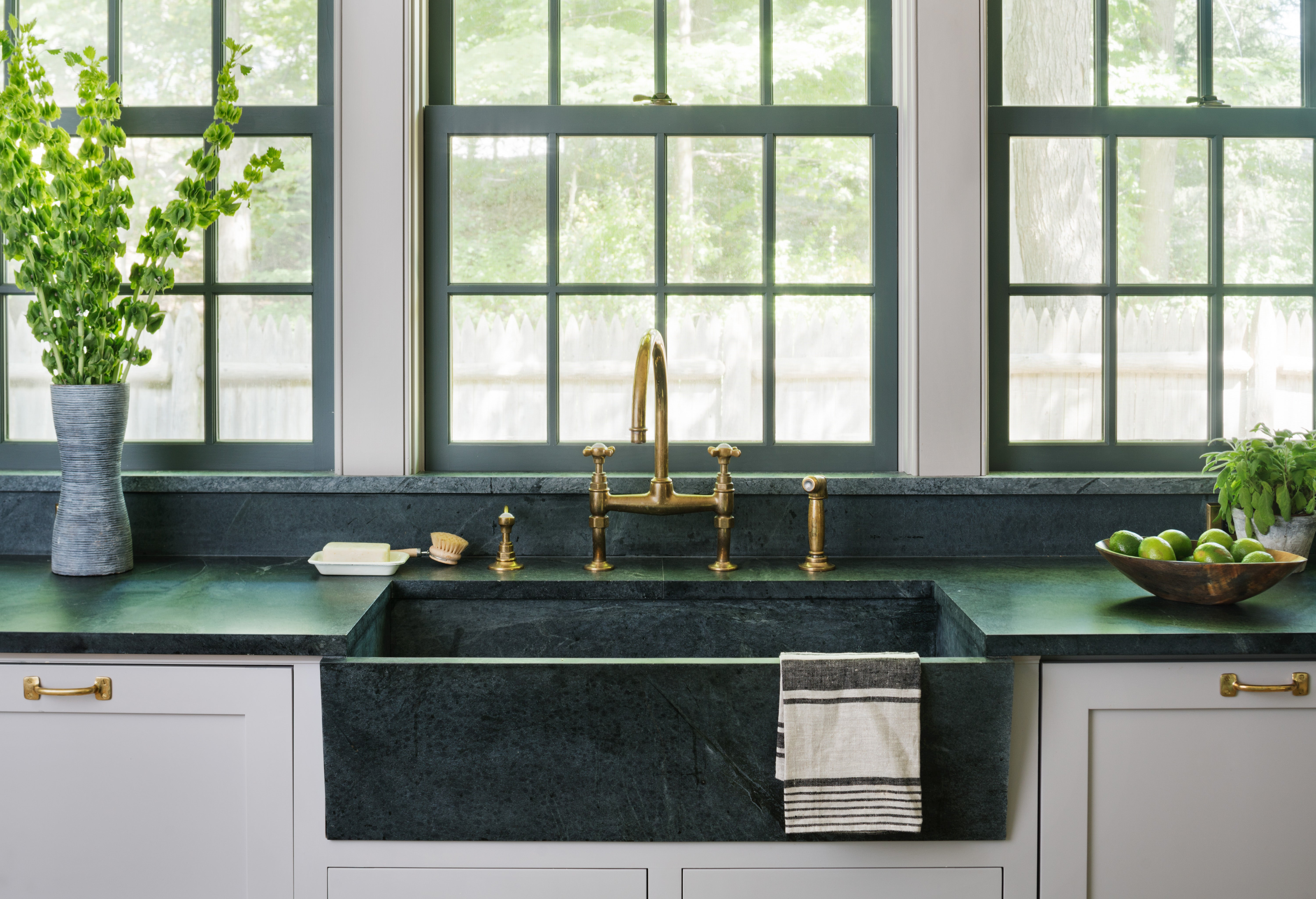 green soapstone counters with farmhouse sink