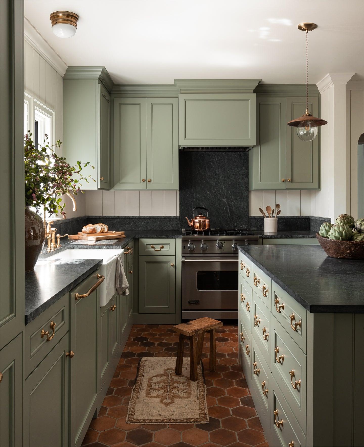 green kitchen with dark black counters