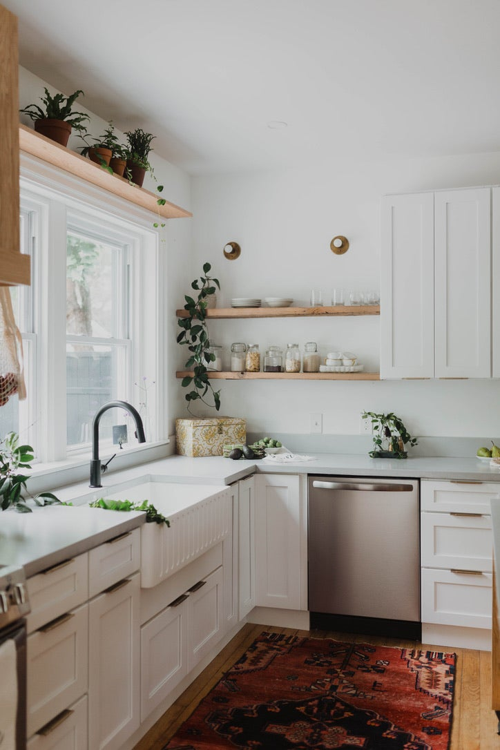 gray kitchen with floating shelves