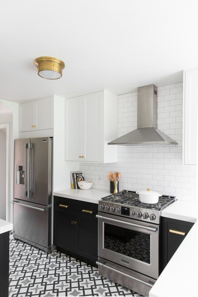black and white kitchen with grey tiles
