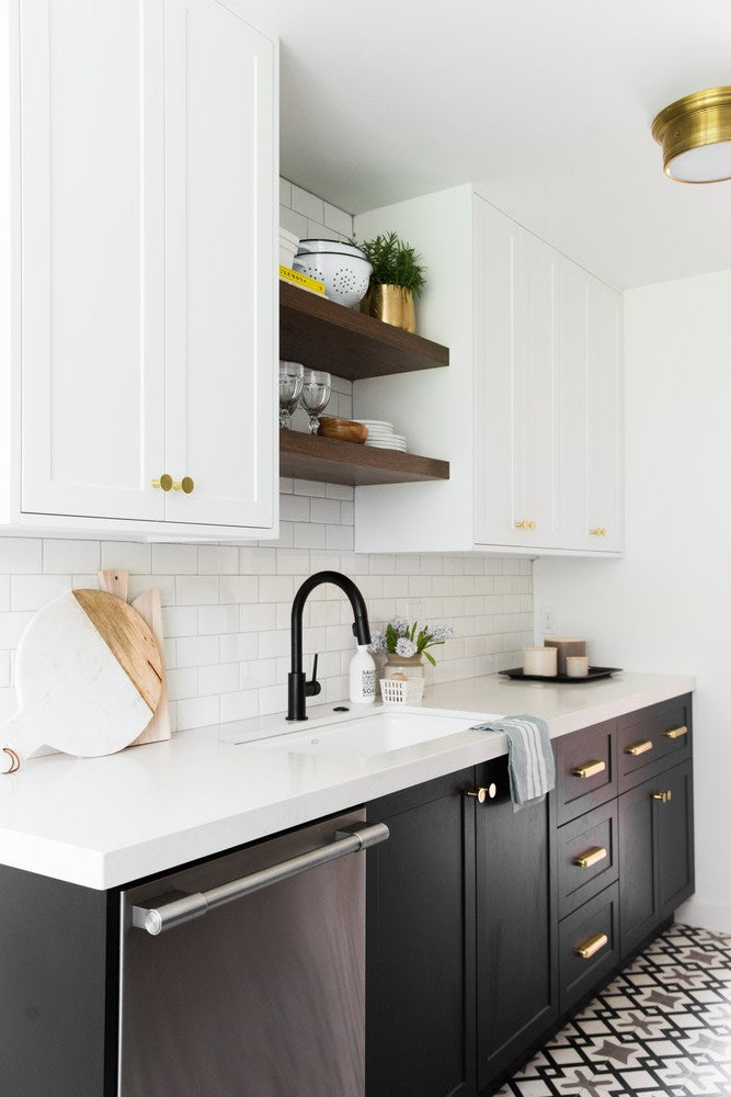 kitchen with black cabinets and open shelving