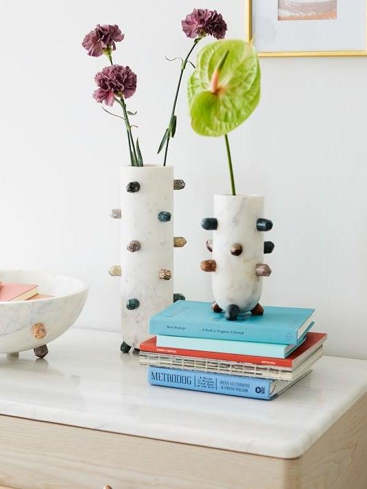bookshelf with white vessels