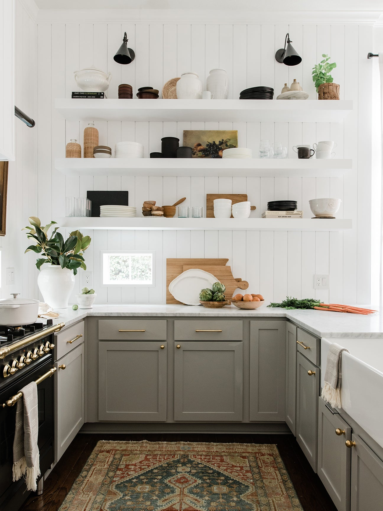 white kitchen with open shelving and gray cabinets