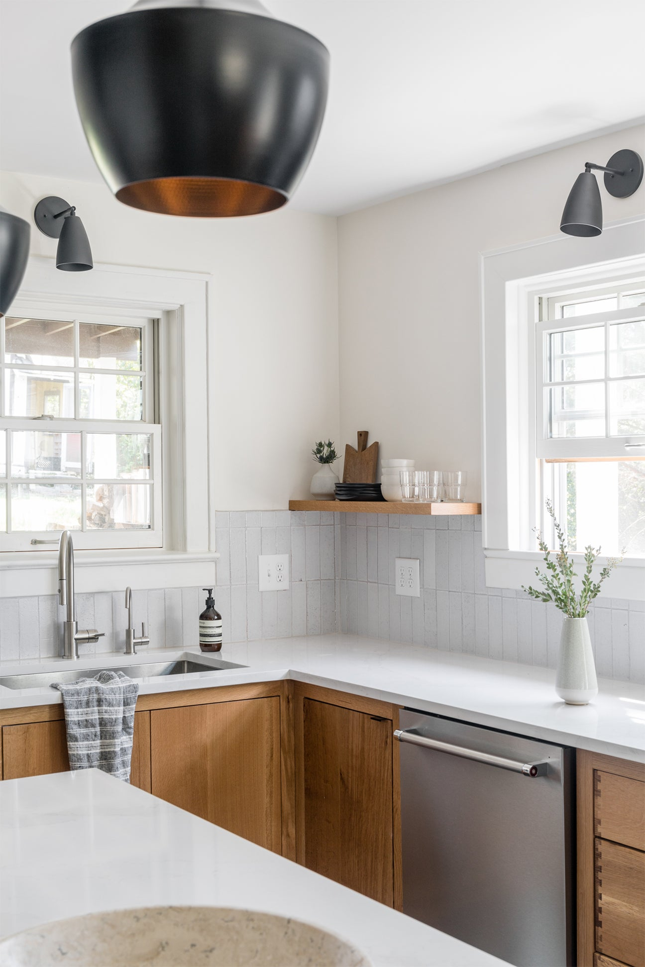 wood cabinets with white counters