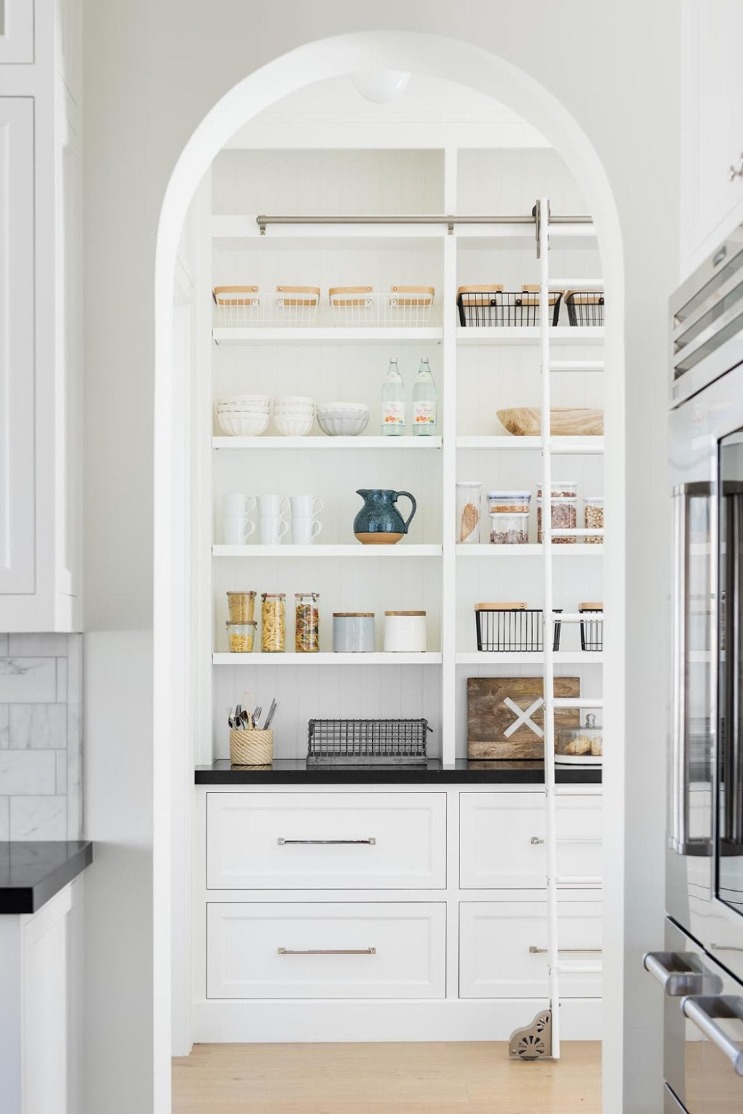 white kitchen pantry with arched ceiling