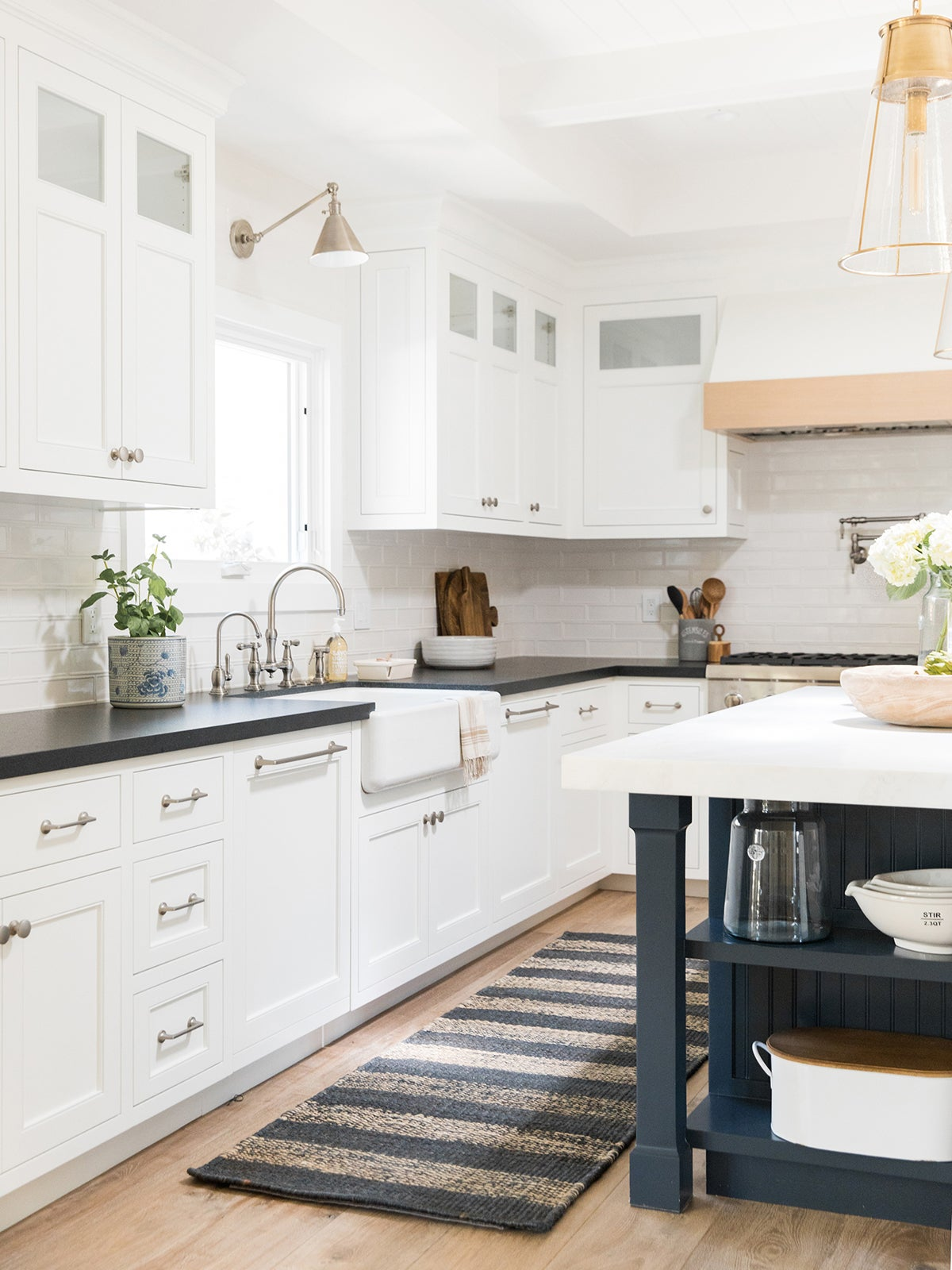 large white kitchen with black counters