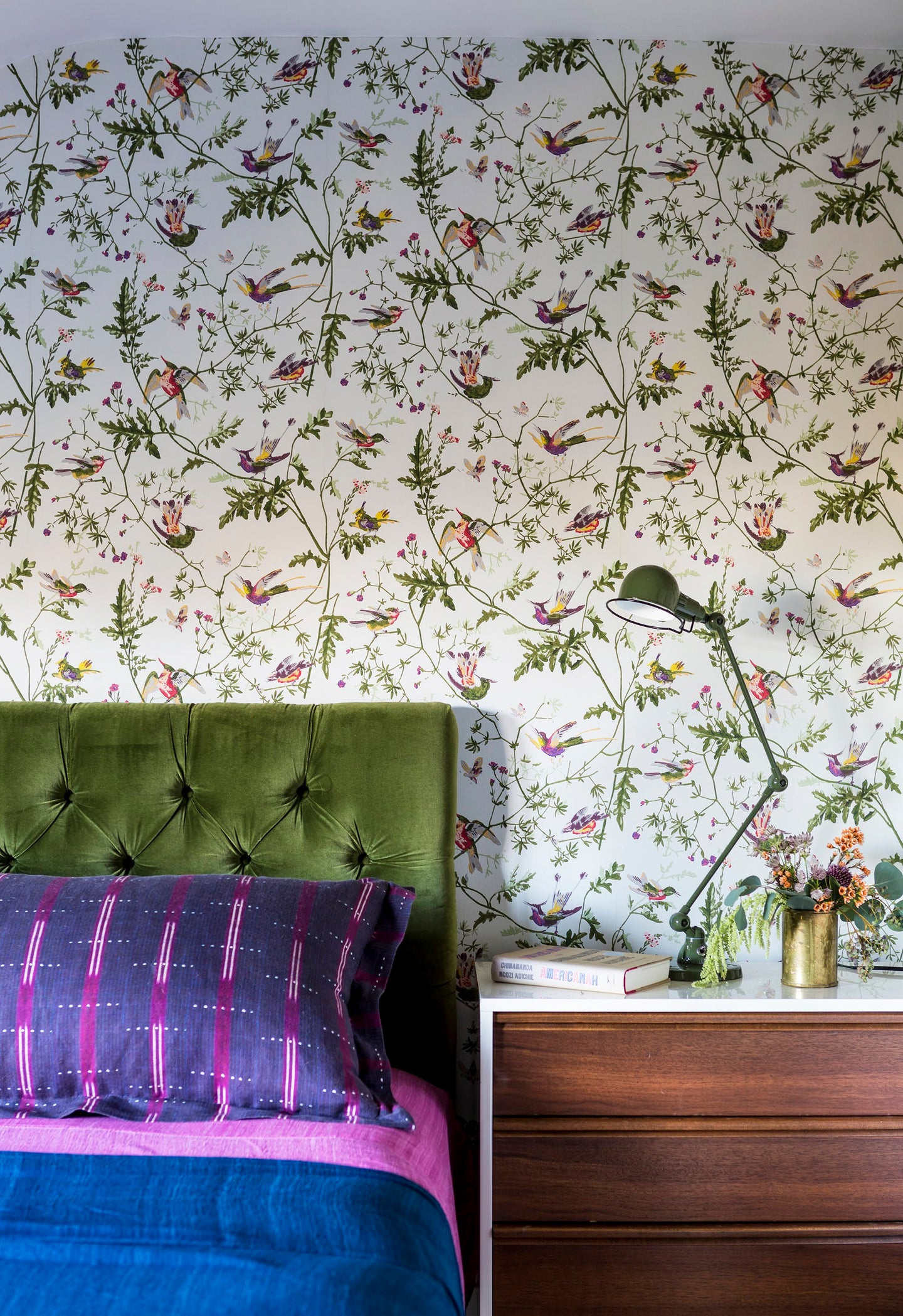 Bedroom with wallpaper and colorful bed