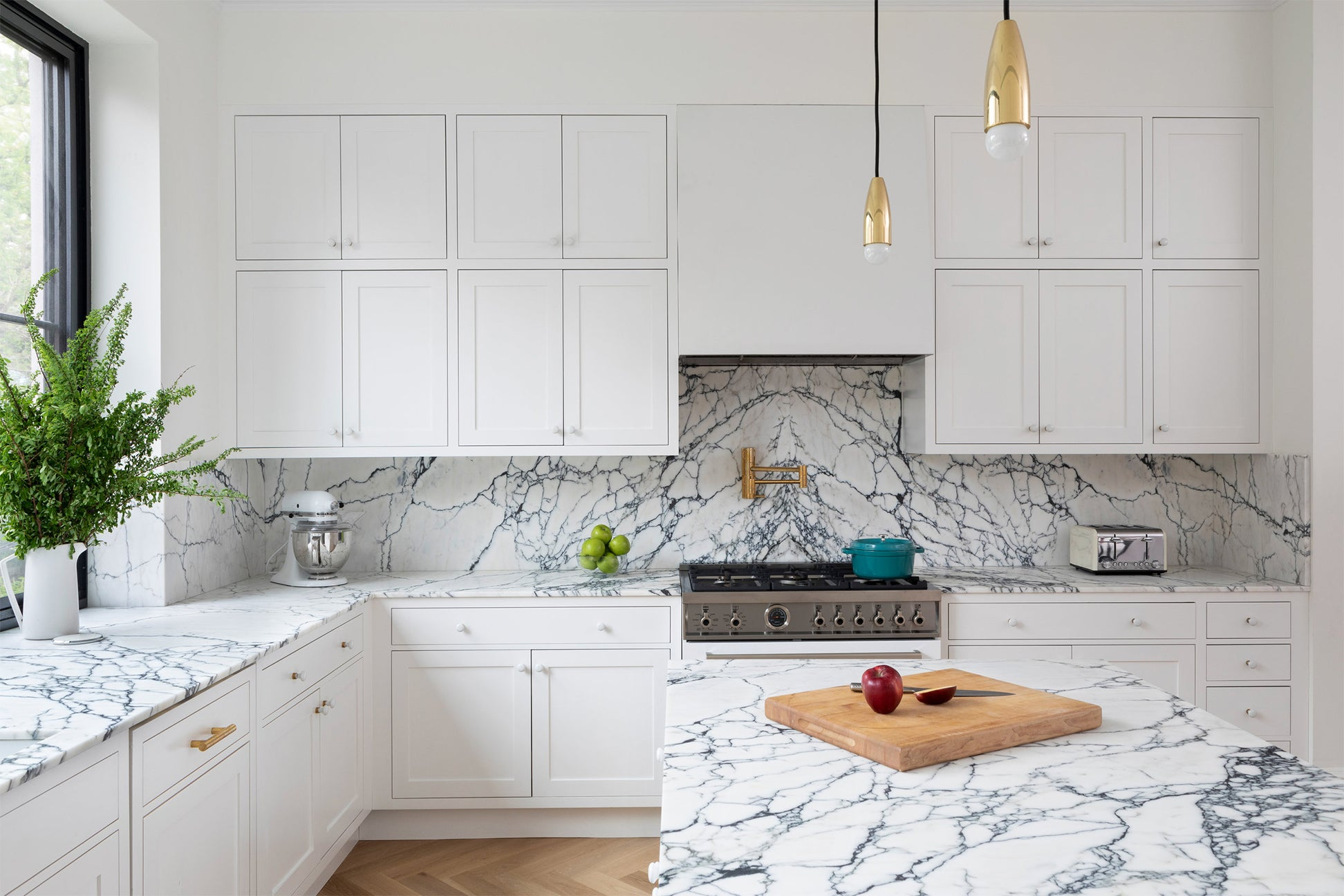 blue marble countertops and white cabinets