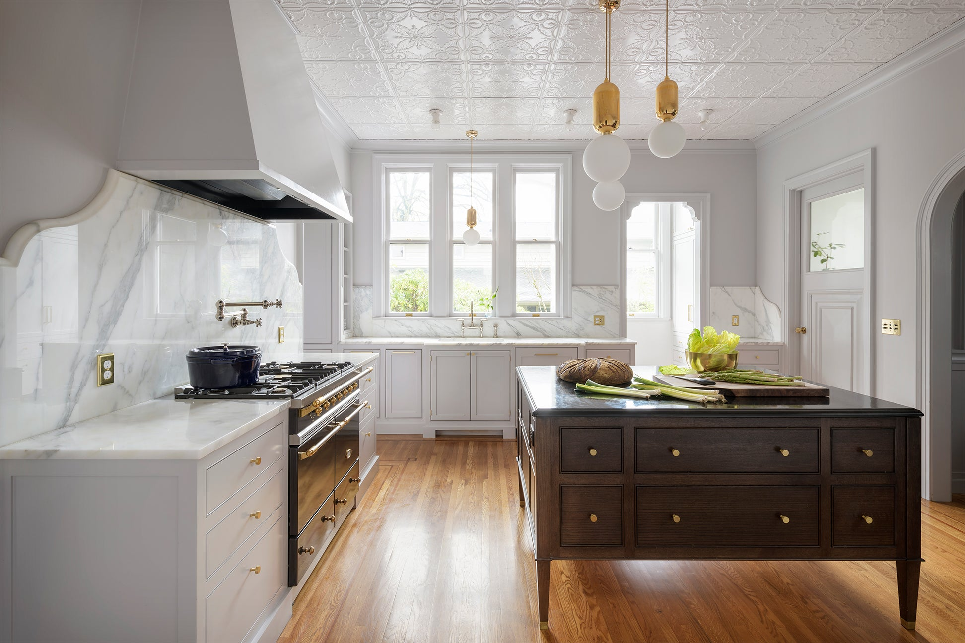 large kitchen with black chest as the island
