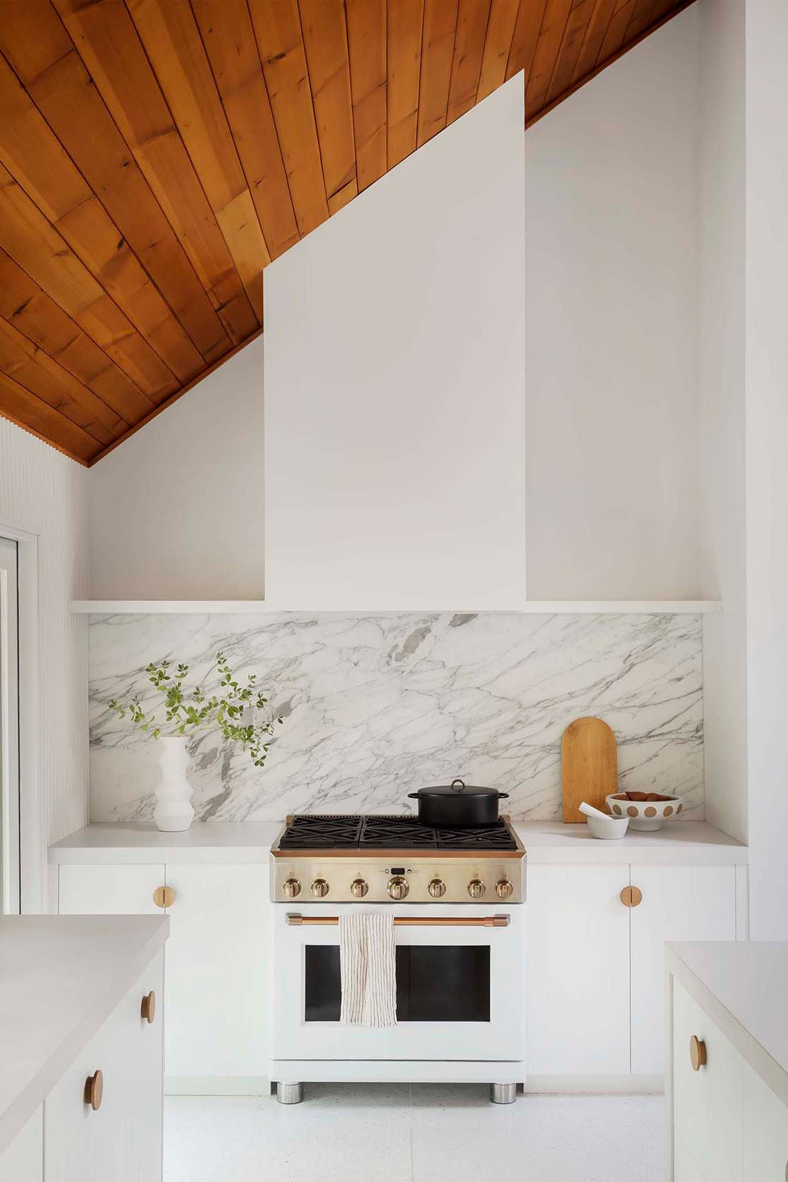 sloped wood ceiling over a stove