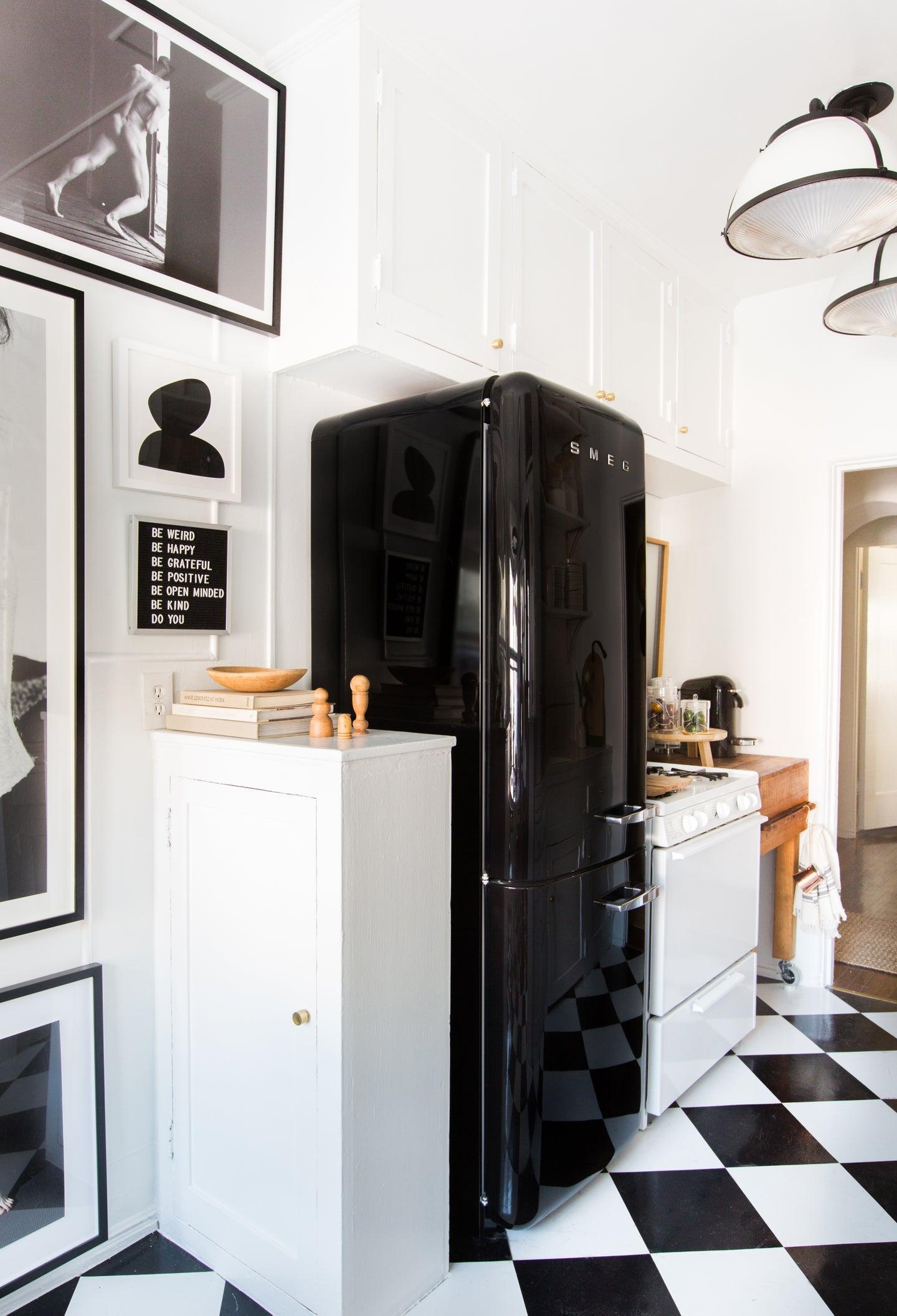 black fridge with balck and white checkered floors