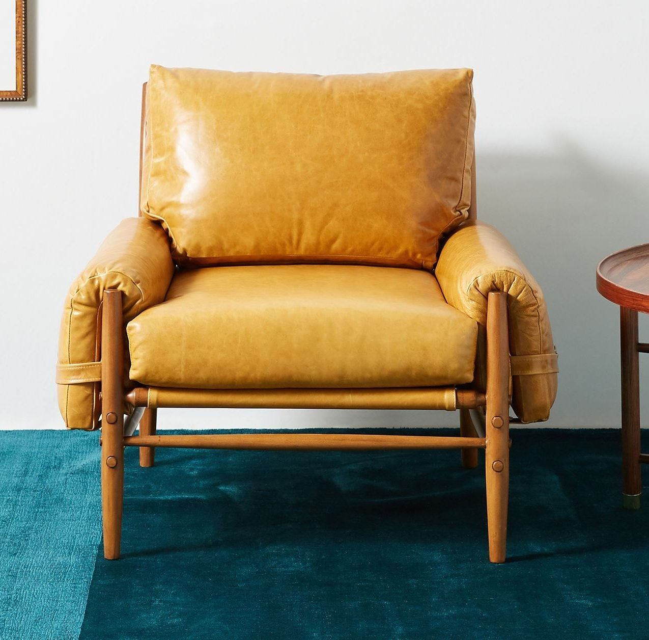leather chair on teal rug