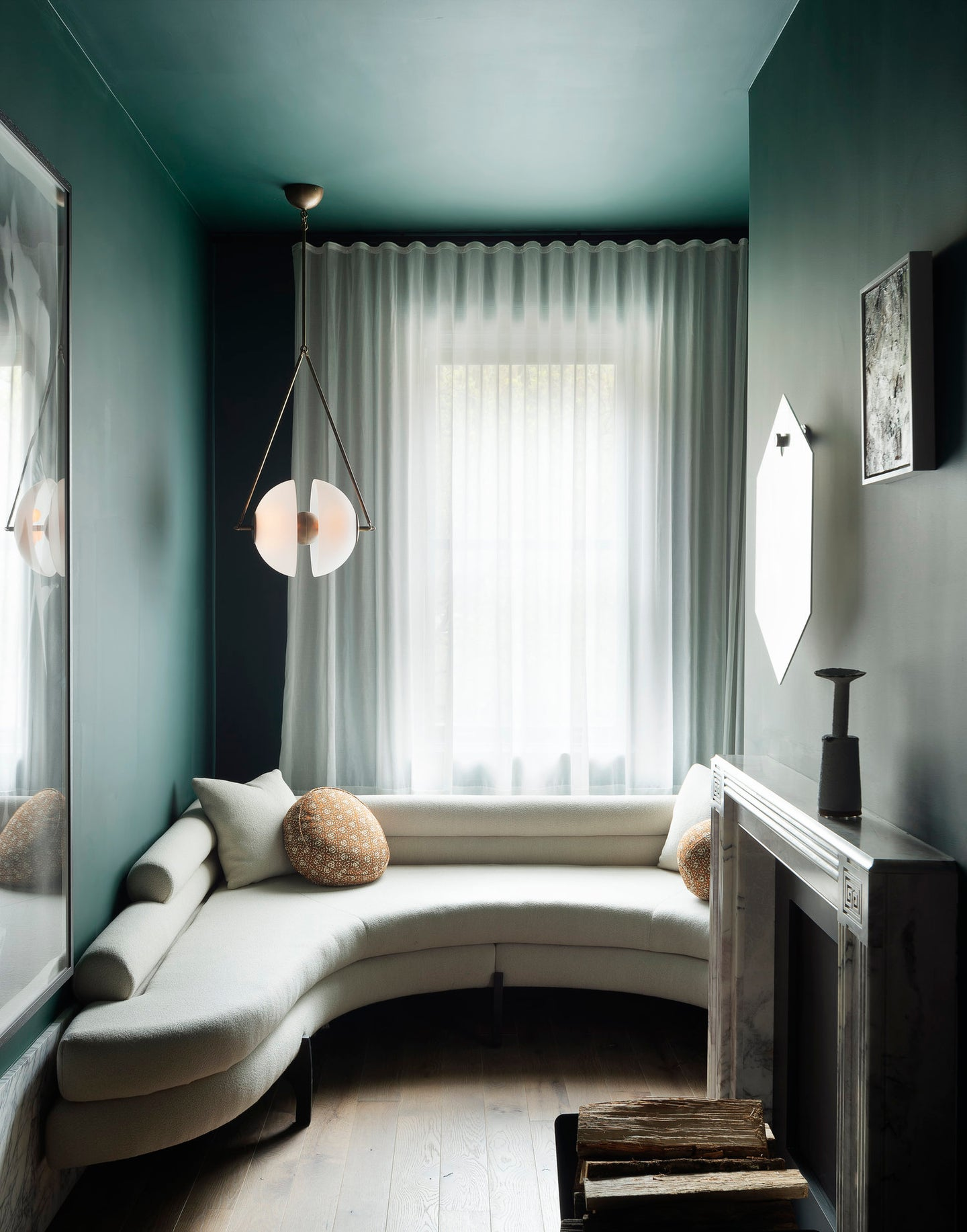 dark green room with l shaped sofa