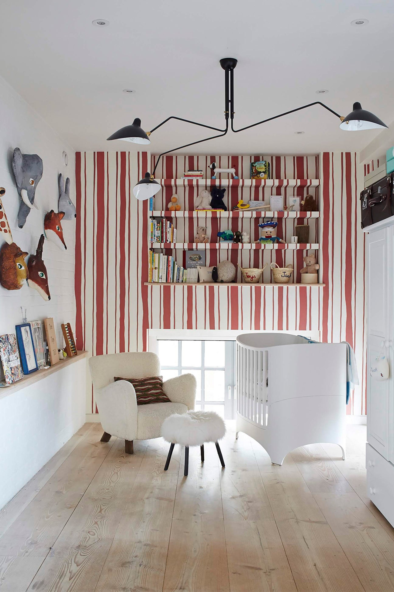 Kids room with striped wallpaper