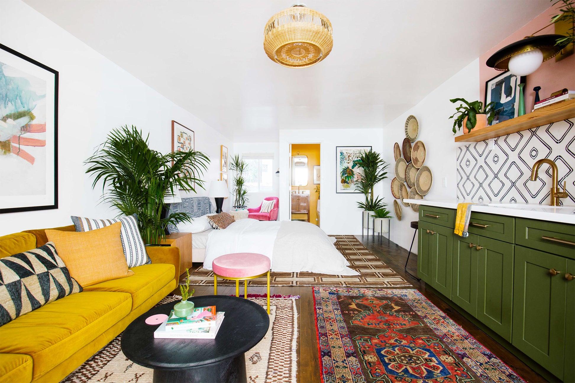 studio apartment with green kitchen