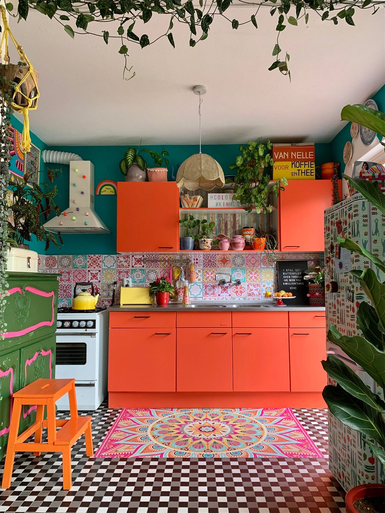 maximalist colorful kitchen with red cabinets