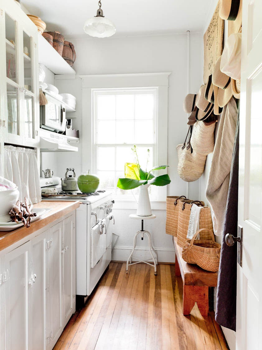 white galley kitchen with butcher block counters