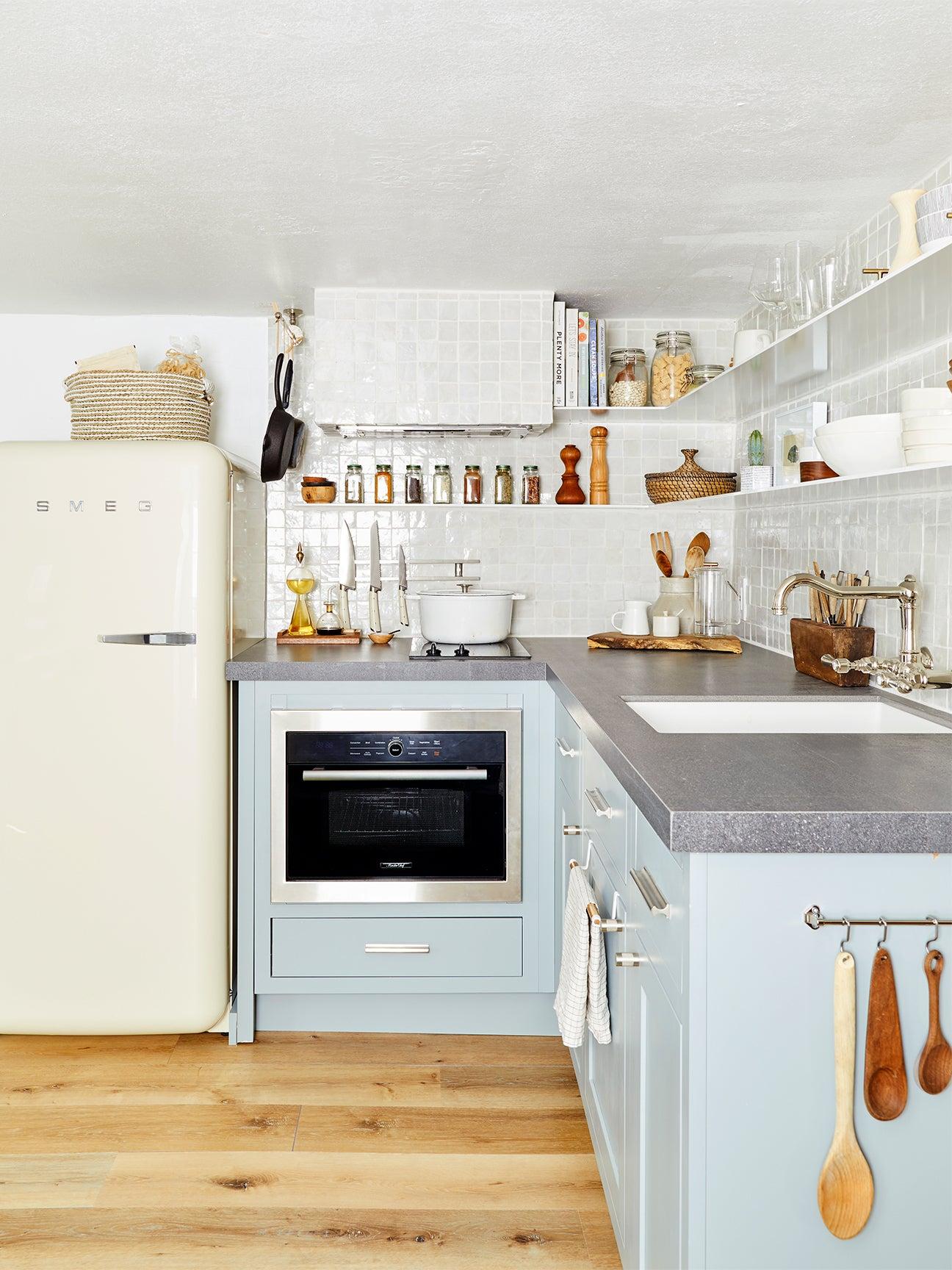 blue kitchen with white smeg fridge