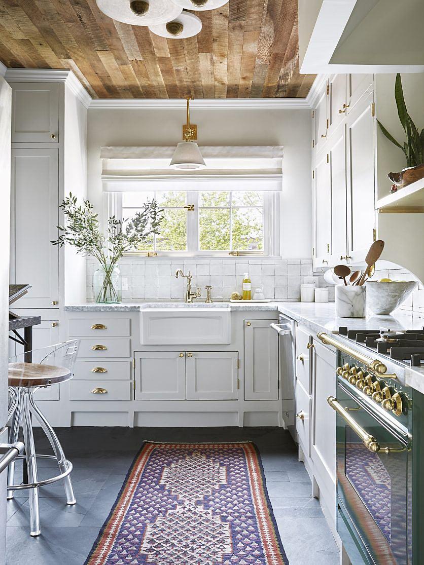 White kitchen with green stove