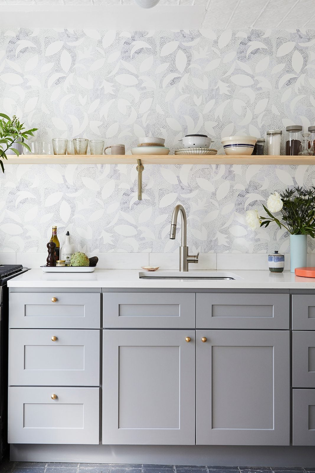 gray cabinets and open kitchen shelves