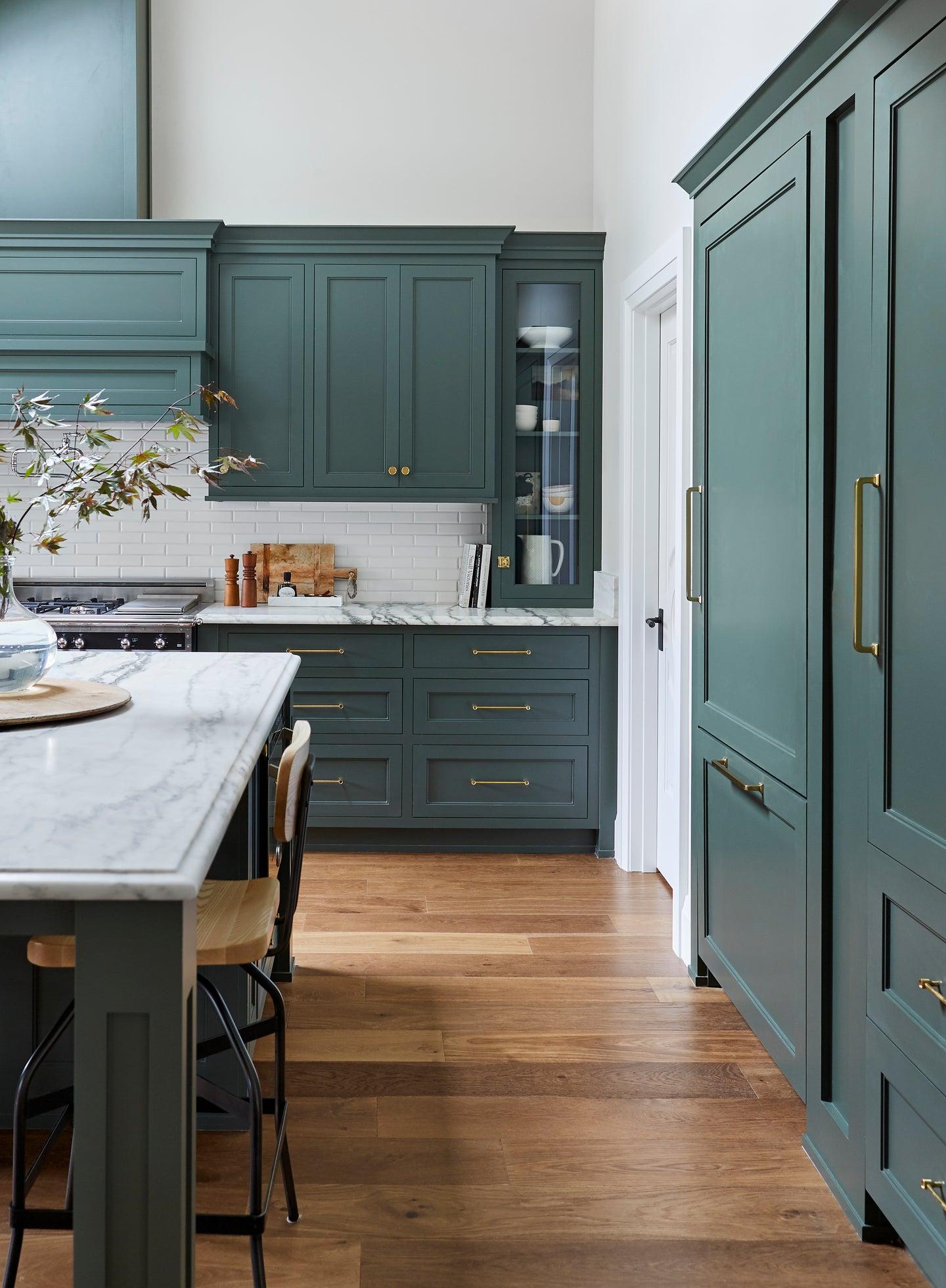 Blue kitchen with hardwood floor