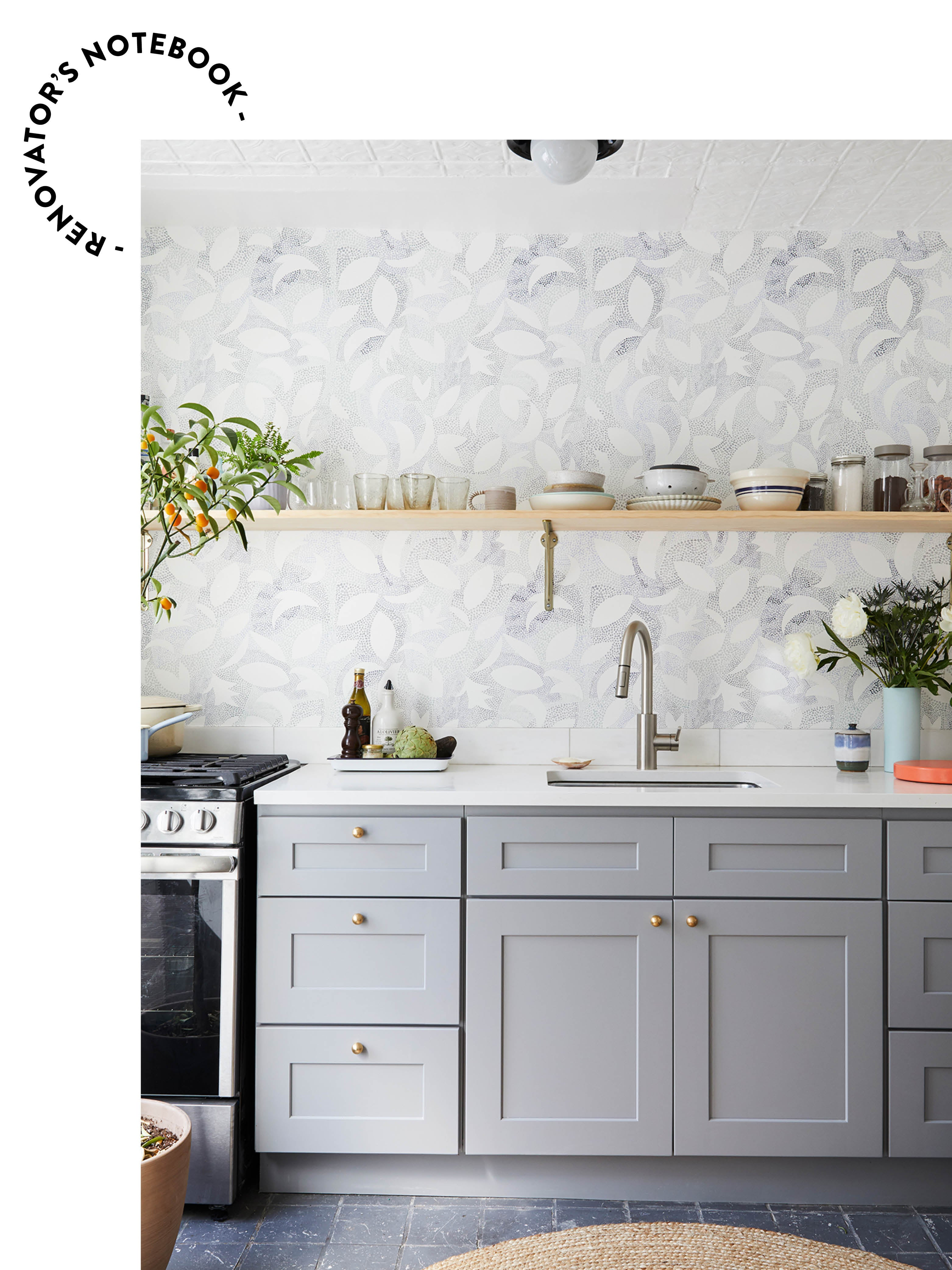 gray kitchen with open shelving and blue wallpaper