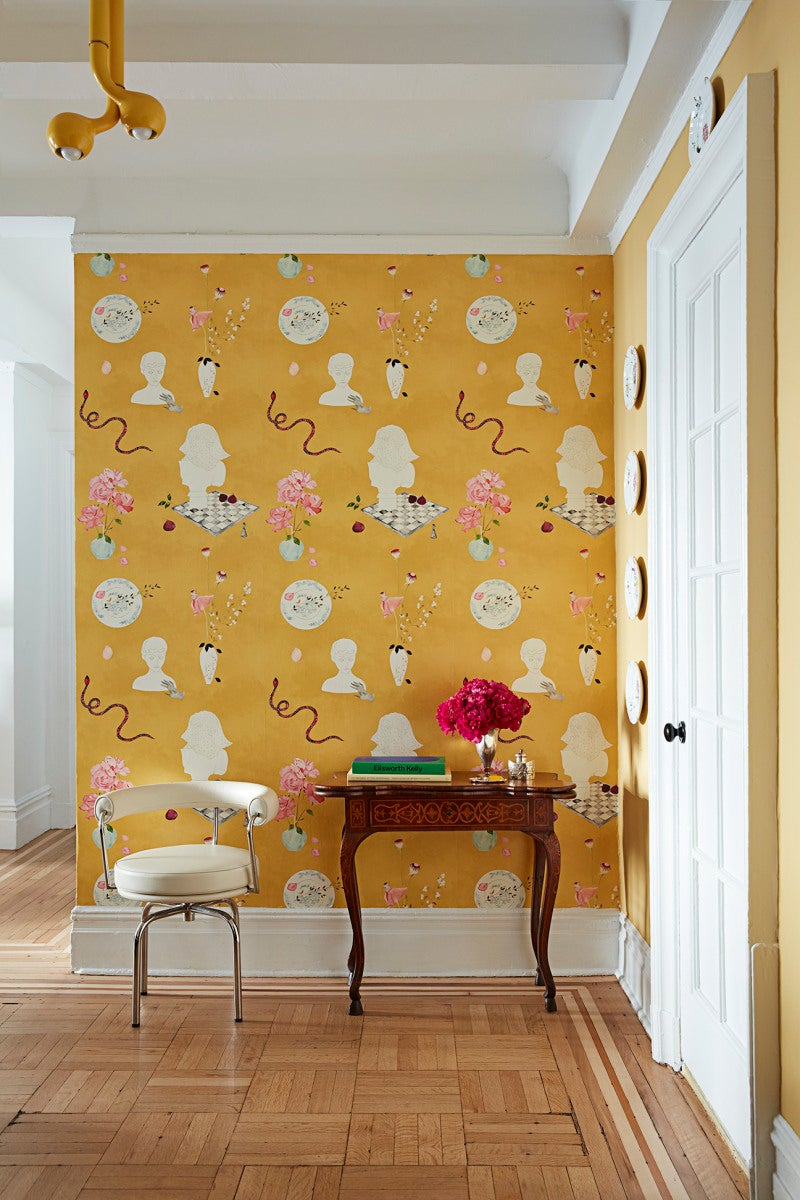 entryway with eclectic yellow wallpaper and small table