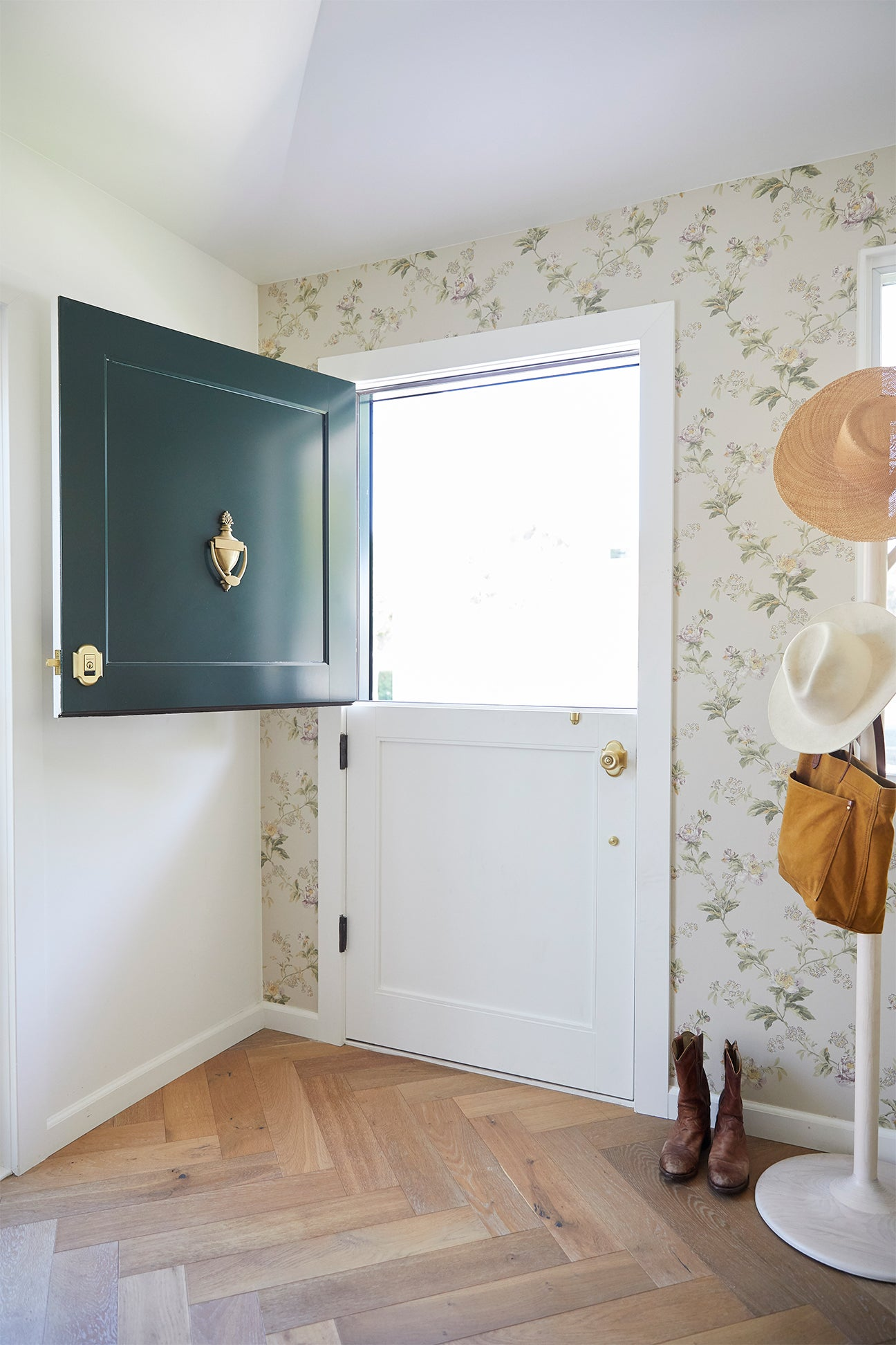 entryway with dutch door and floral wallpaper
