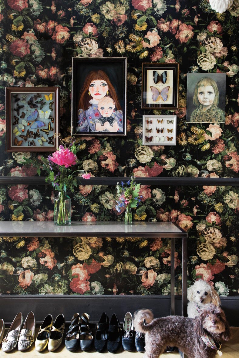 Entryway with dark floral wallpaper and gallery wall