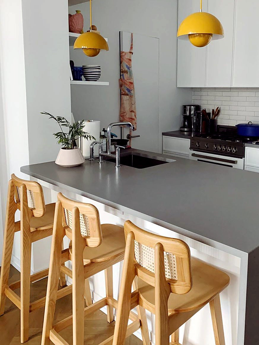 kitchen with yellow pendant lights