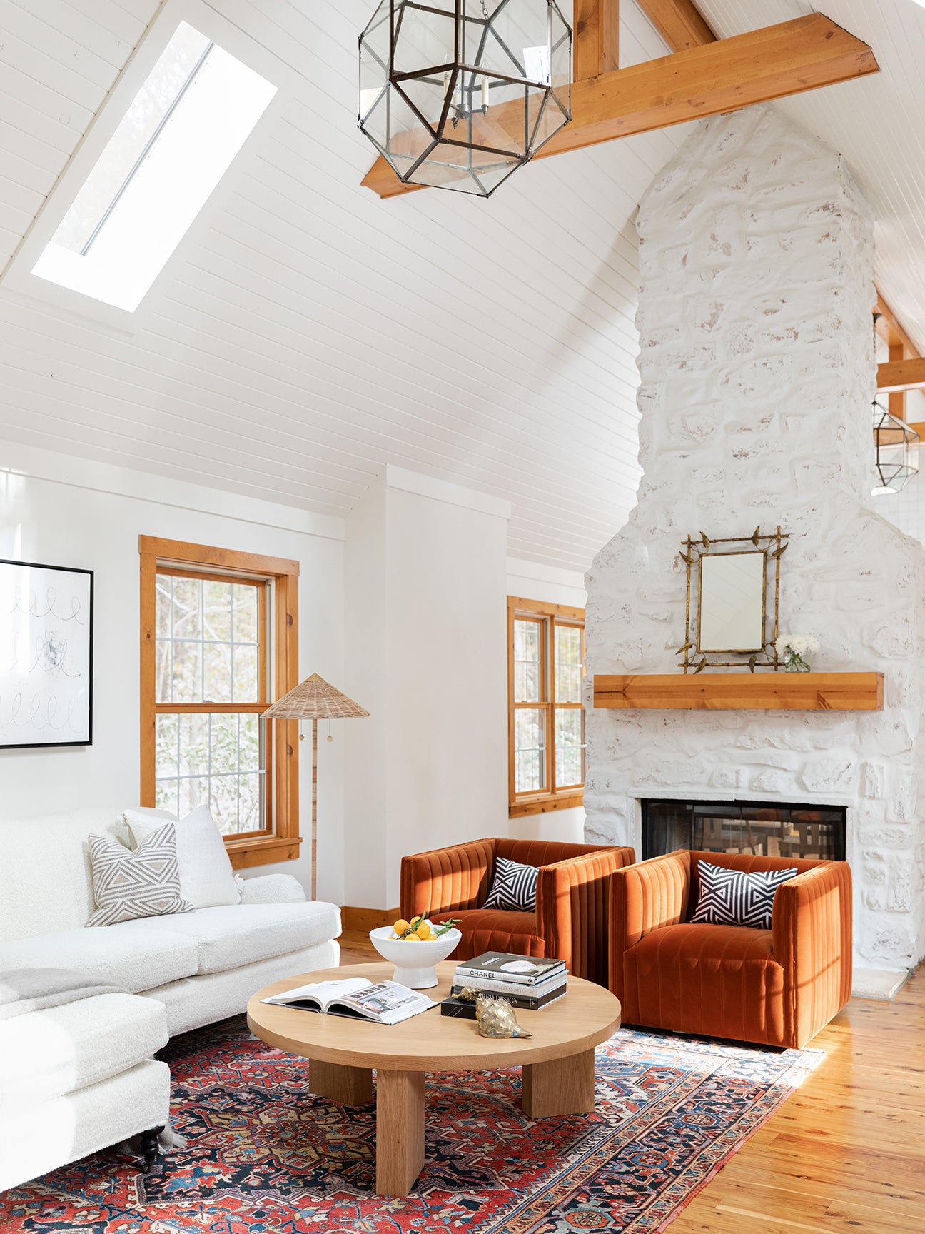 white a-frame living room with fireplace