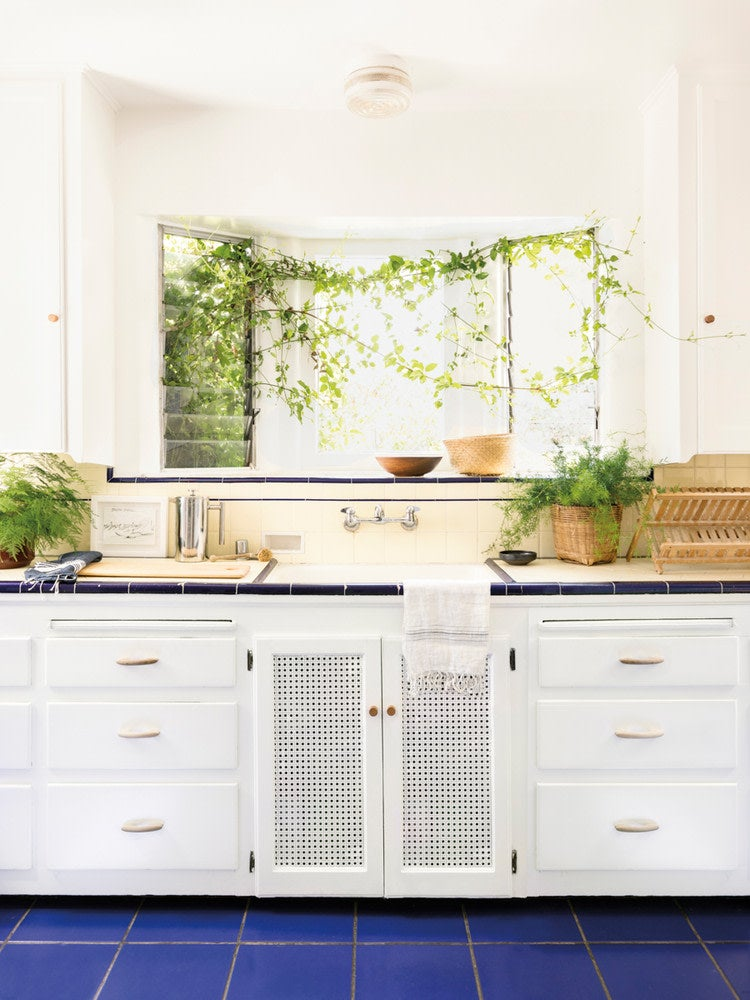 blue and white tiled kitchen counter