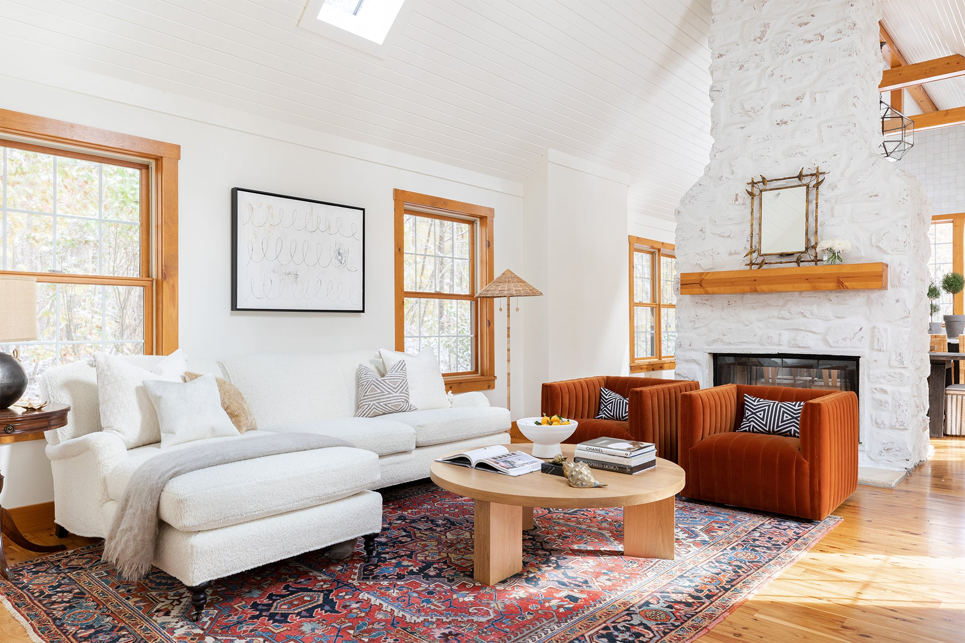 white living room with orange chairs