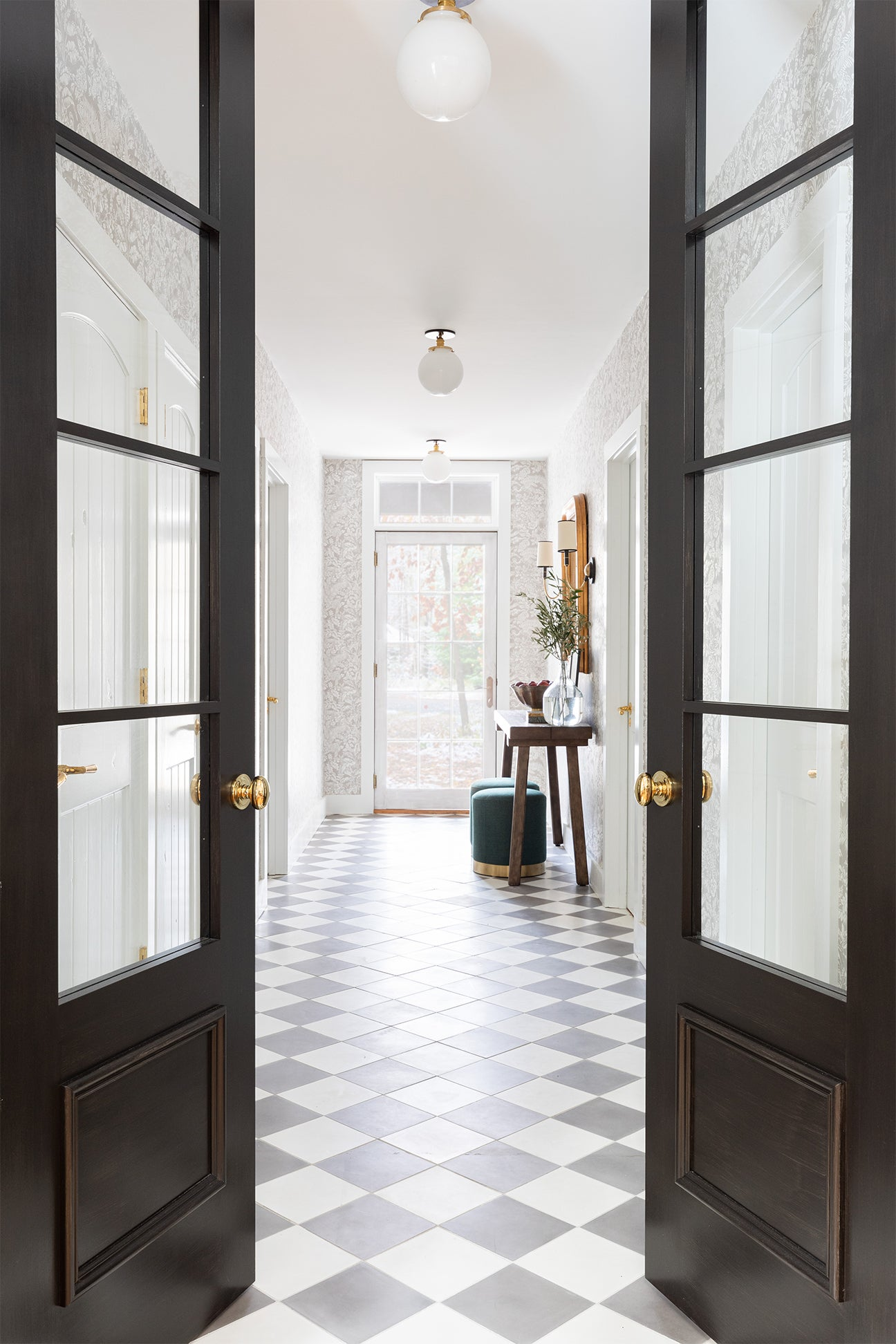 hallway with checkerboard floors