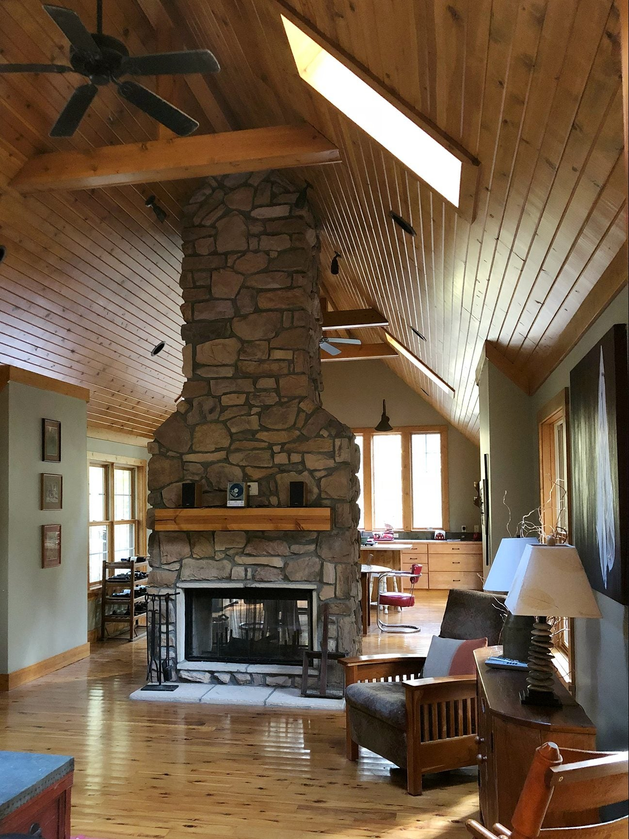 old cabin-style living room with stone fireplace