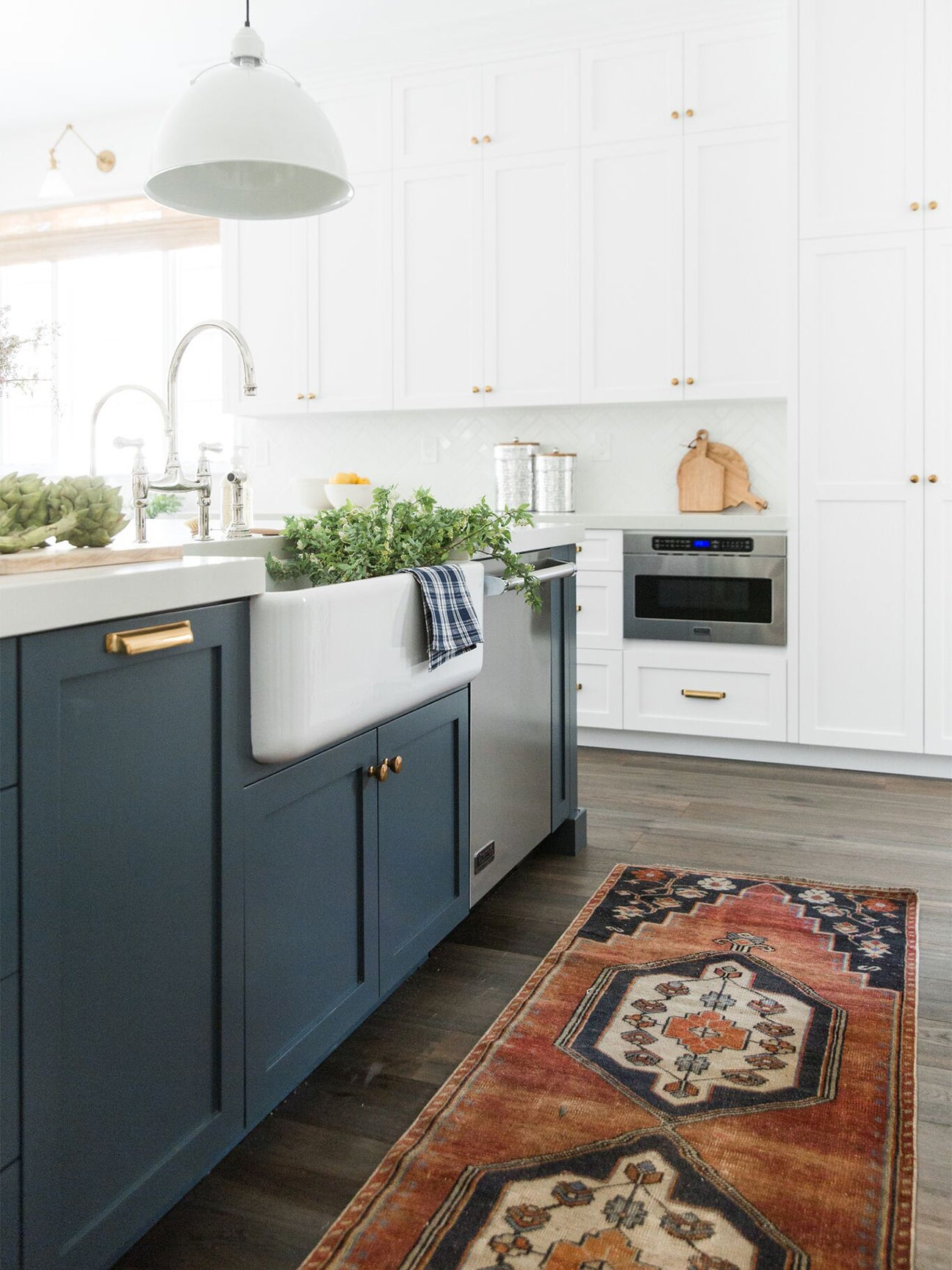 Blue and white kitchen with vintage runner