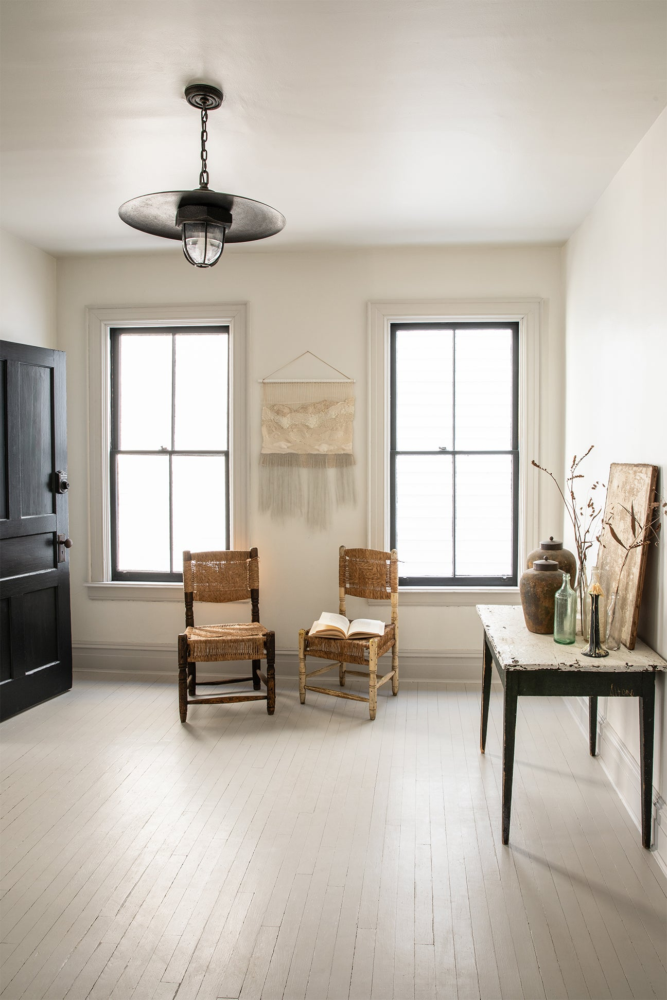open living room with white floors