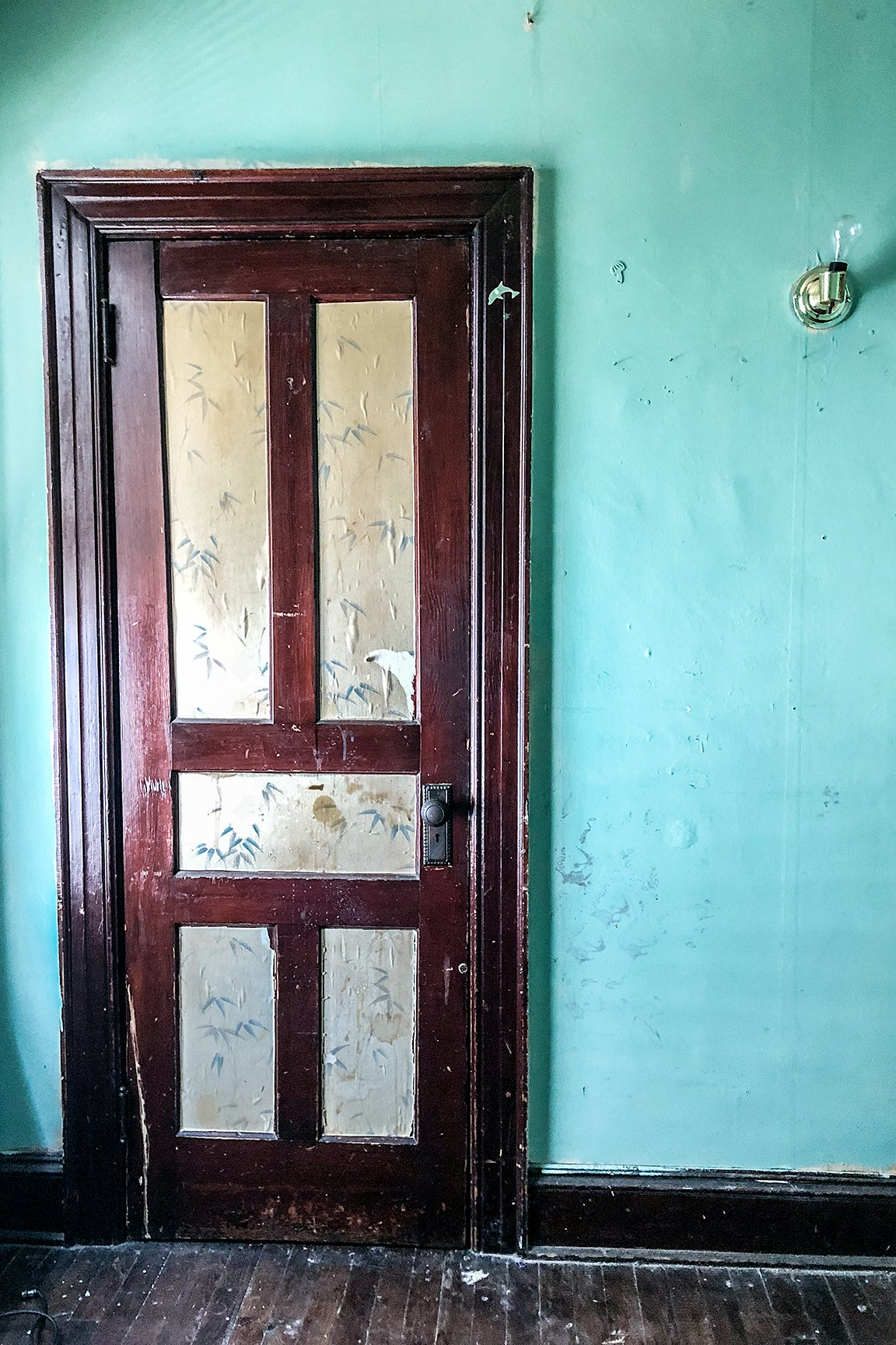 turquoise wall with old door
