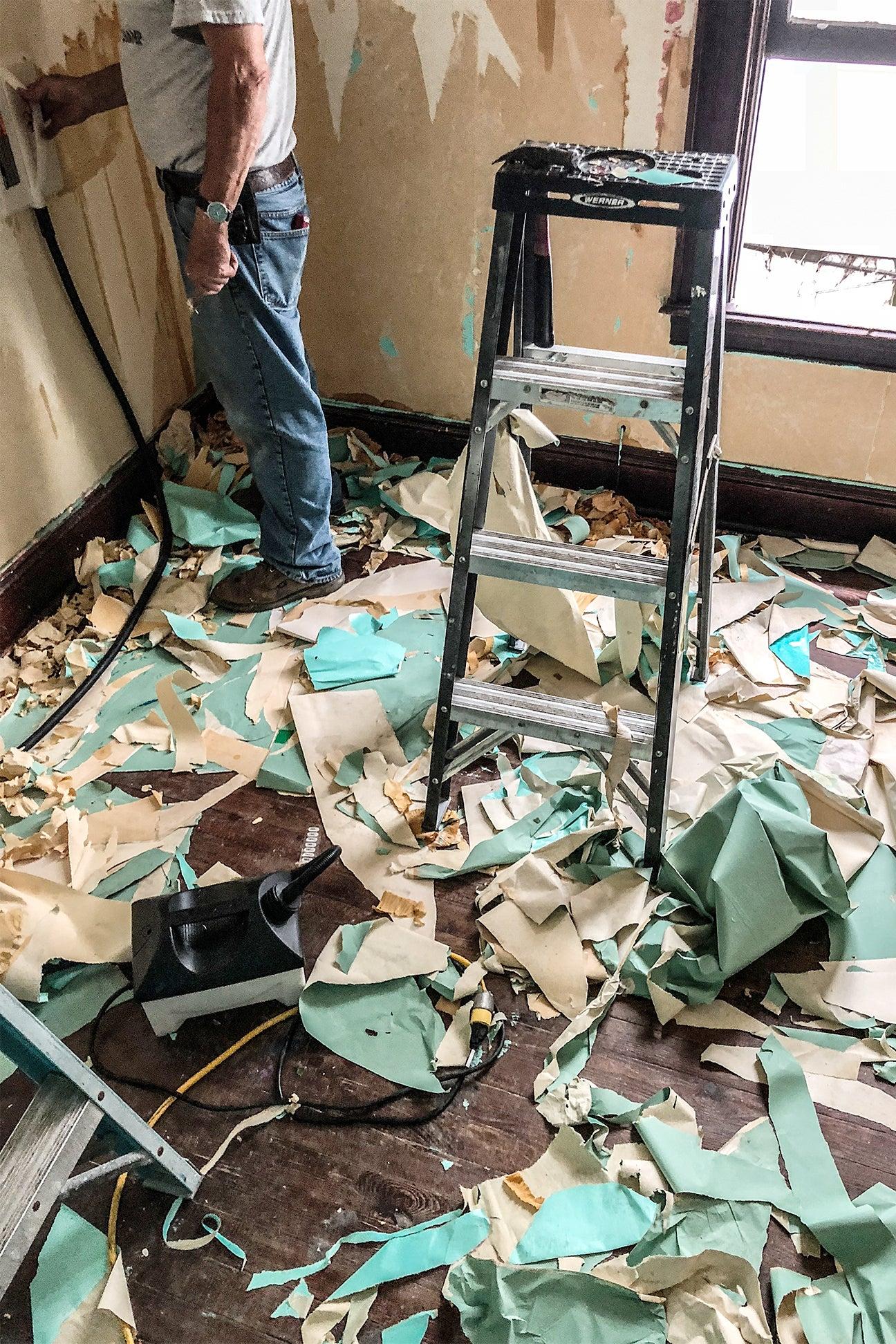 wallpaper scraps on floor