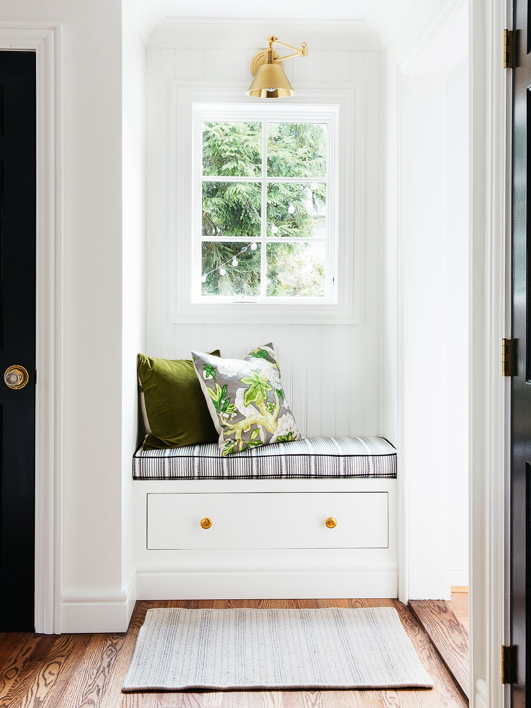 built in bench with floral pillows