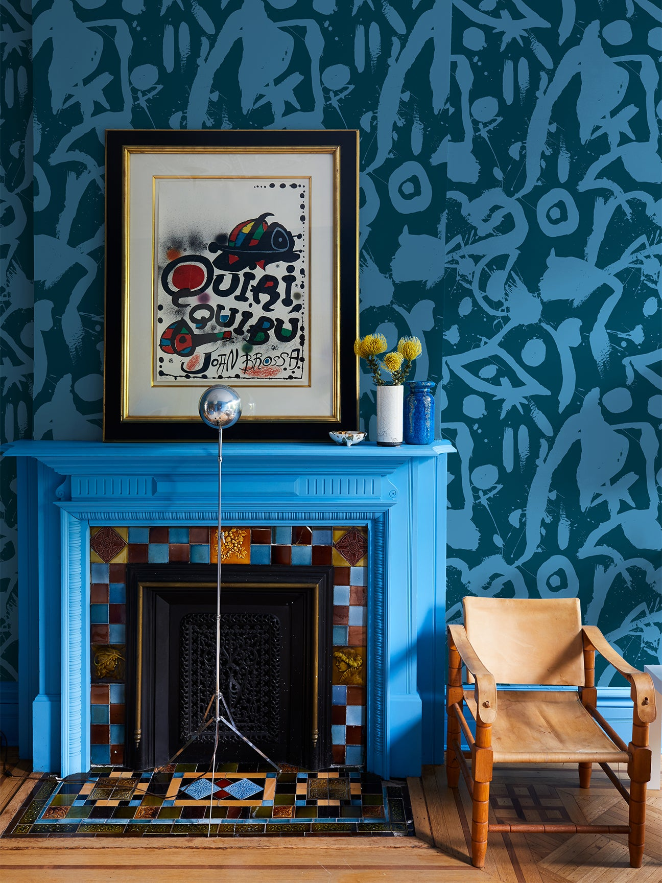 bright blue fireplace with wallpaper