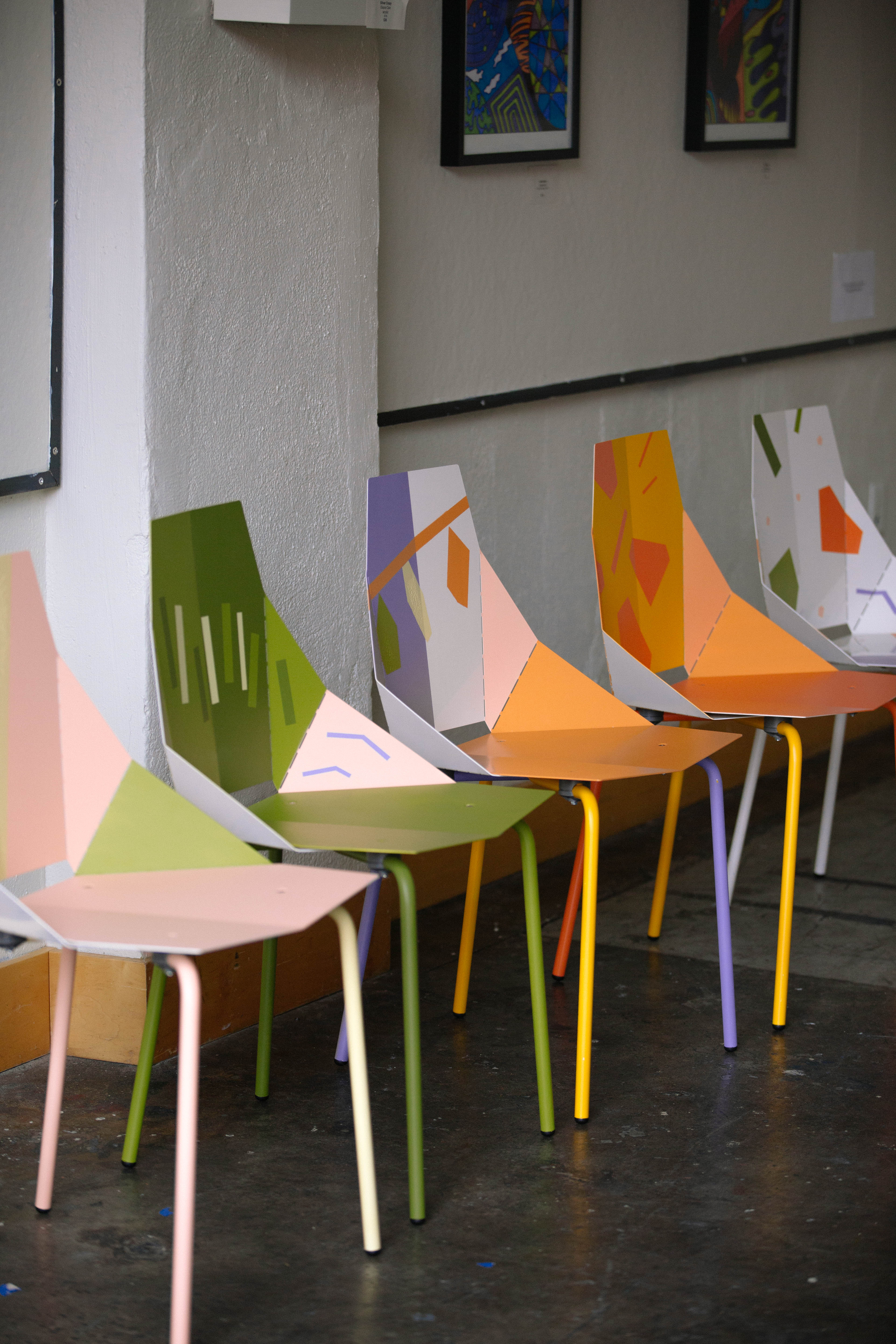 five colorful chairs in a row