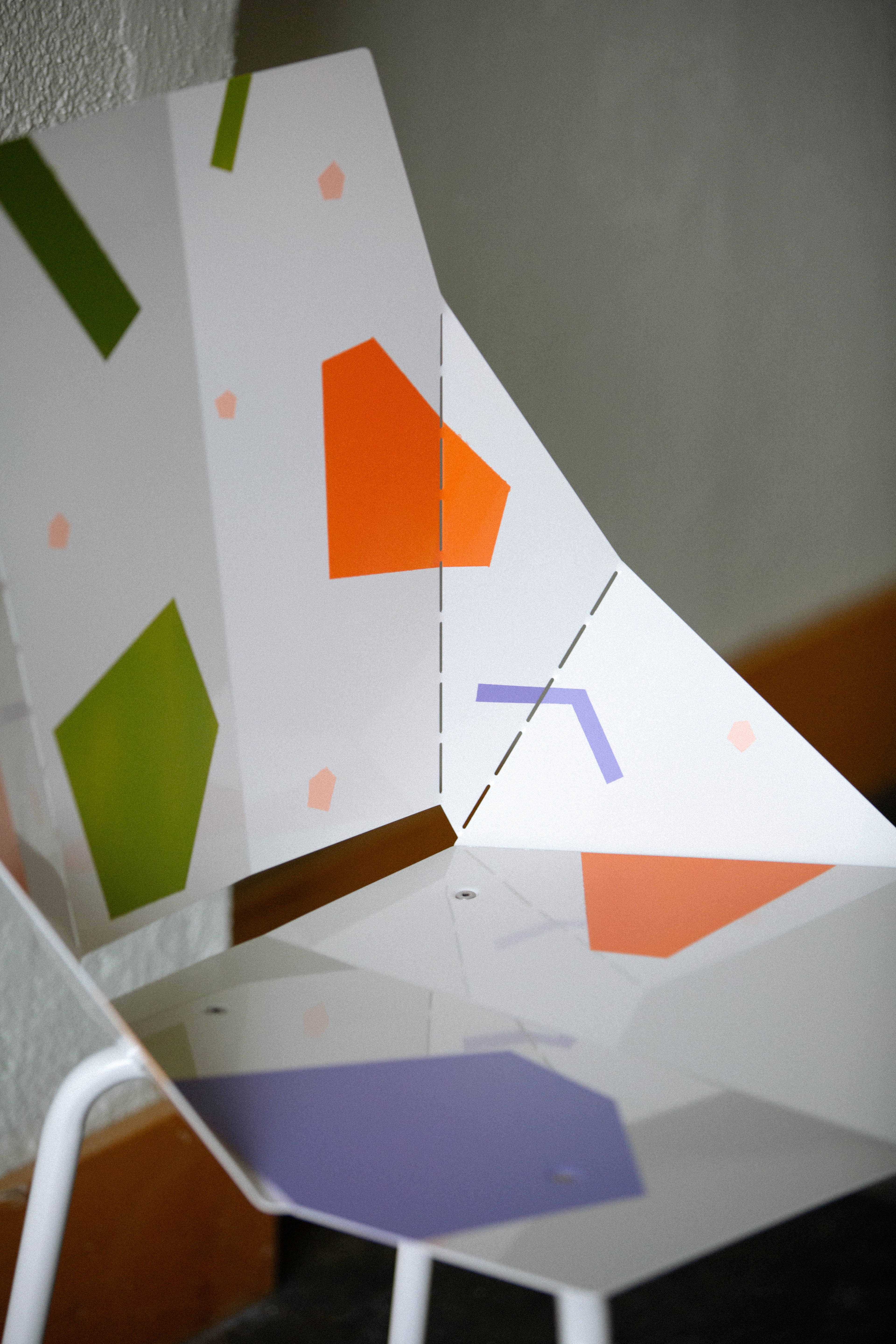 white chair with colorful shapes