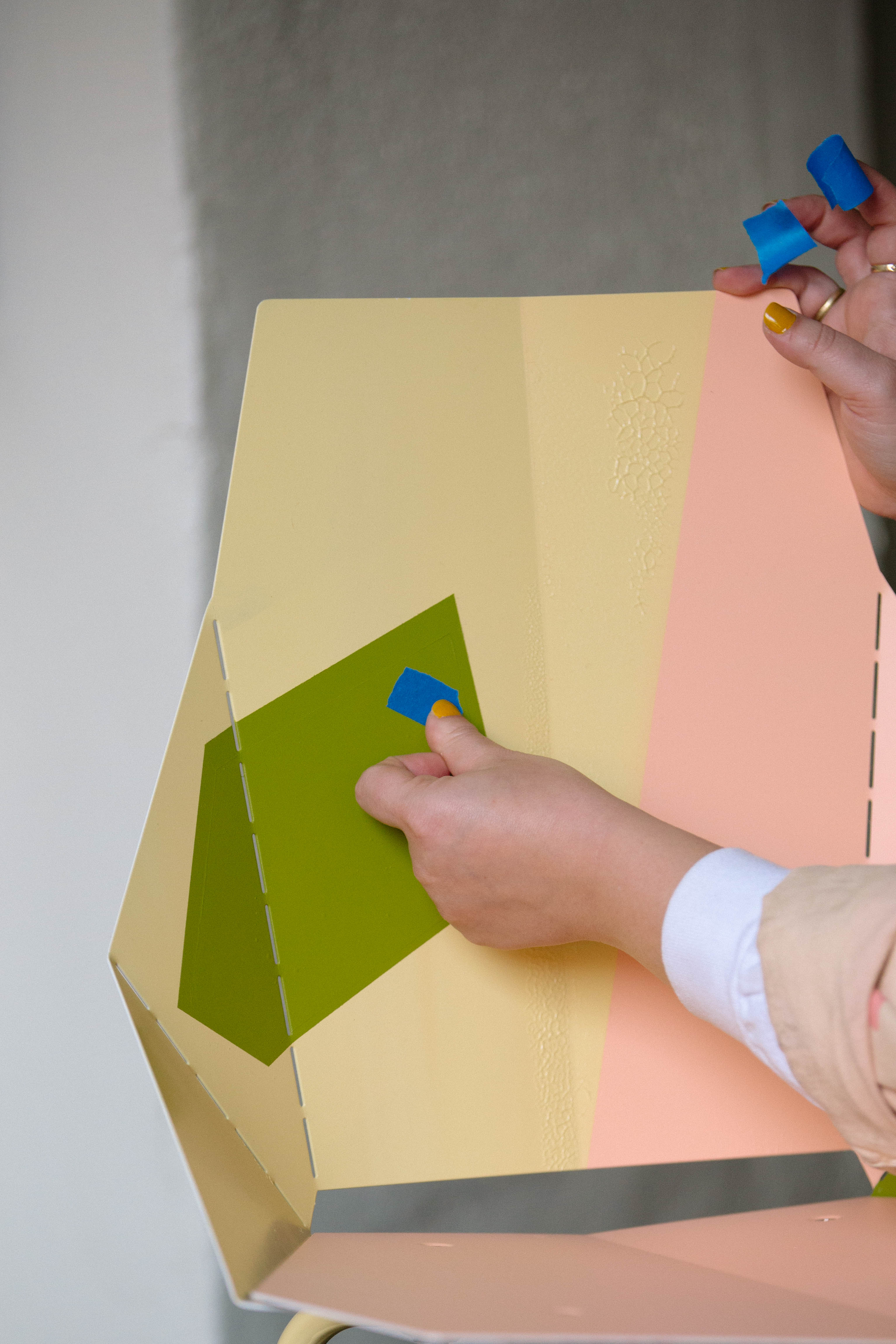 person painting a chair