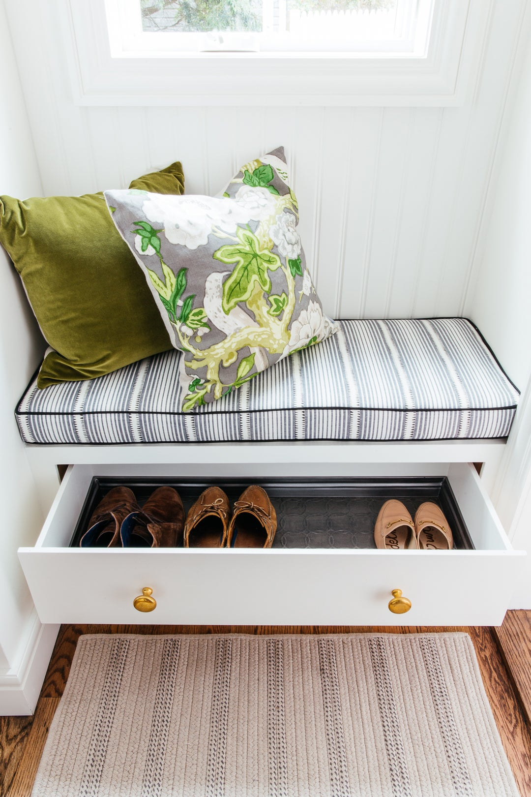 built in bench wiht a drawer half way open