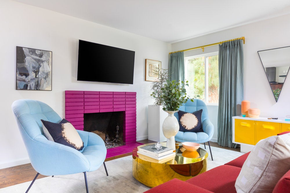 bright pink fireplace in white living room