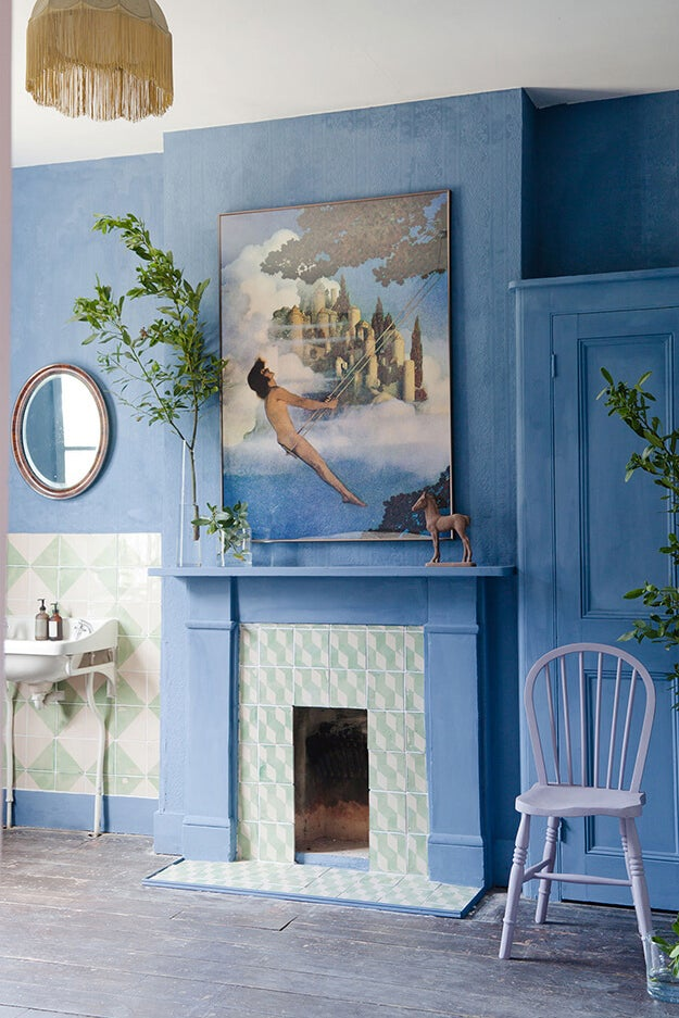 light blue room with fireplace